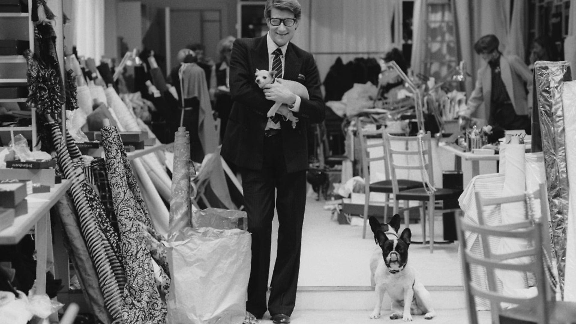 French fashion designer Yves Saint Laurent (1936 - 2008) in his Paris studio, January 1982. (Photo by John Downing/Getty Images) - Credit: Getty Images