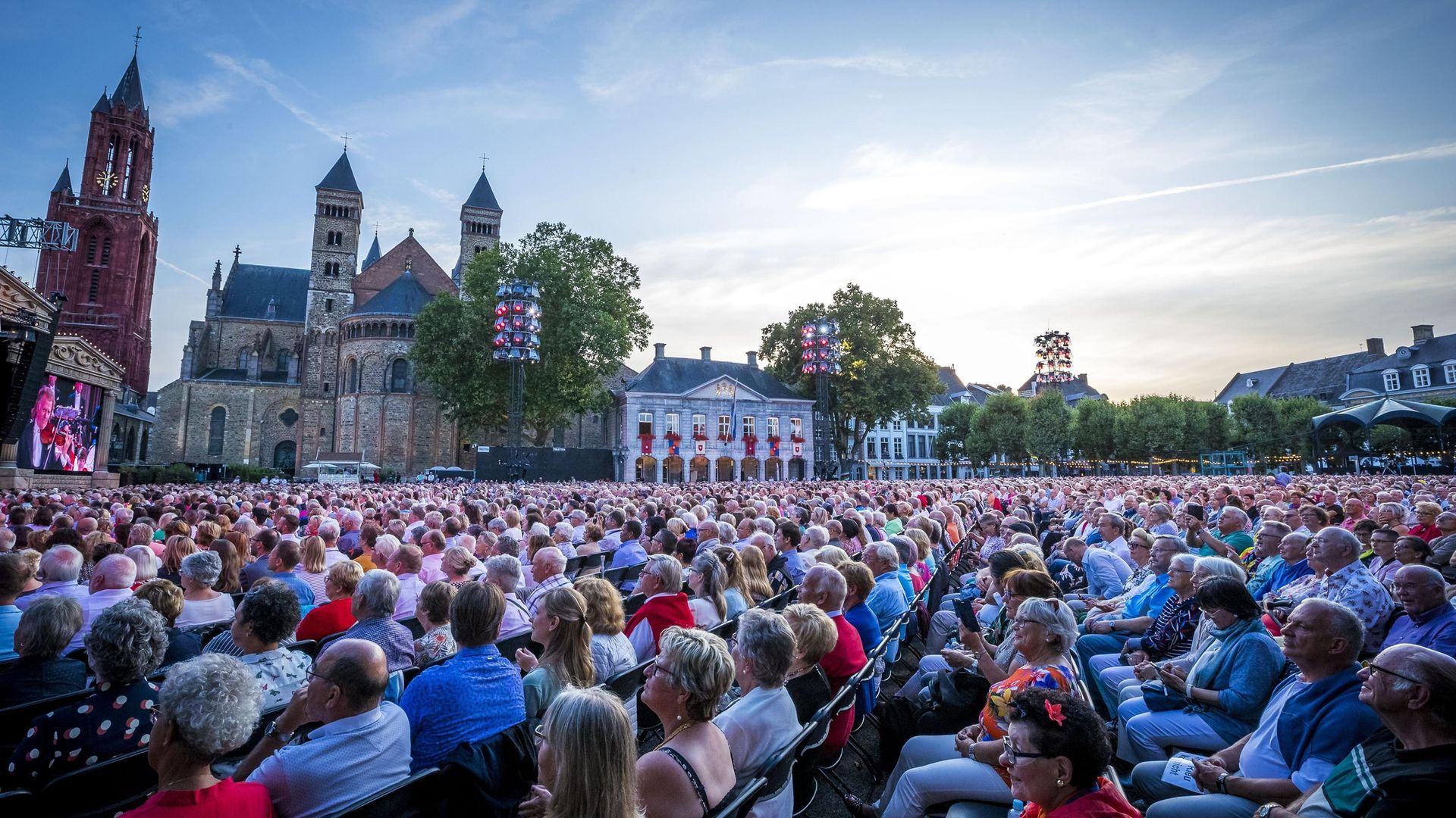 People attend a concert of Dutch violinist and concert director Andre Rieu as he performs for the 100th time on the Vrijthof square in Maastricht, on July 21, 2019. - Credit: AFP via Getty Images