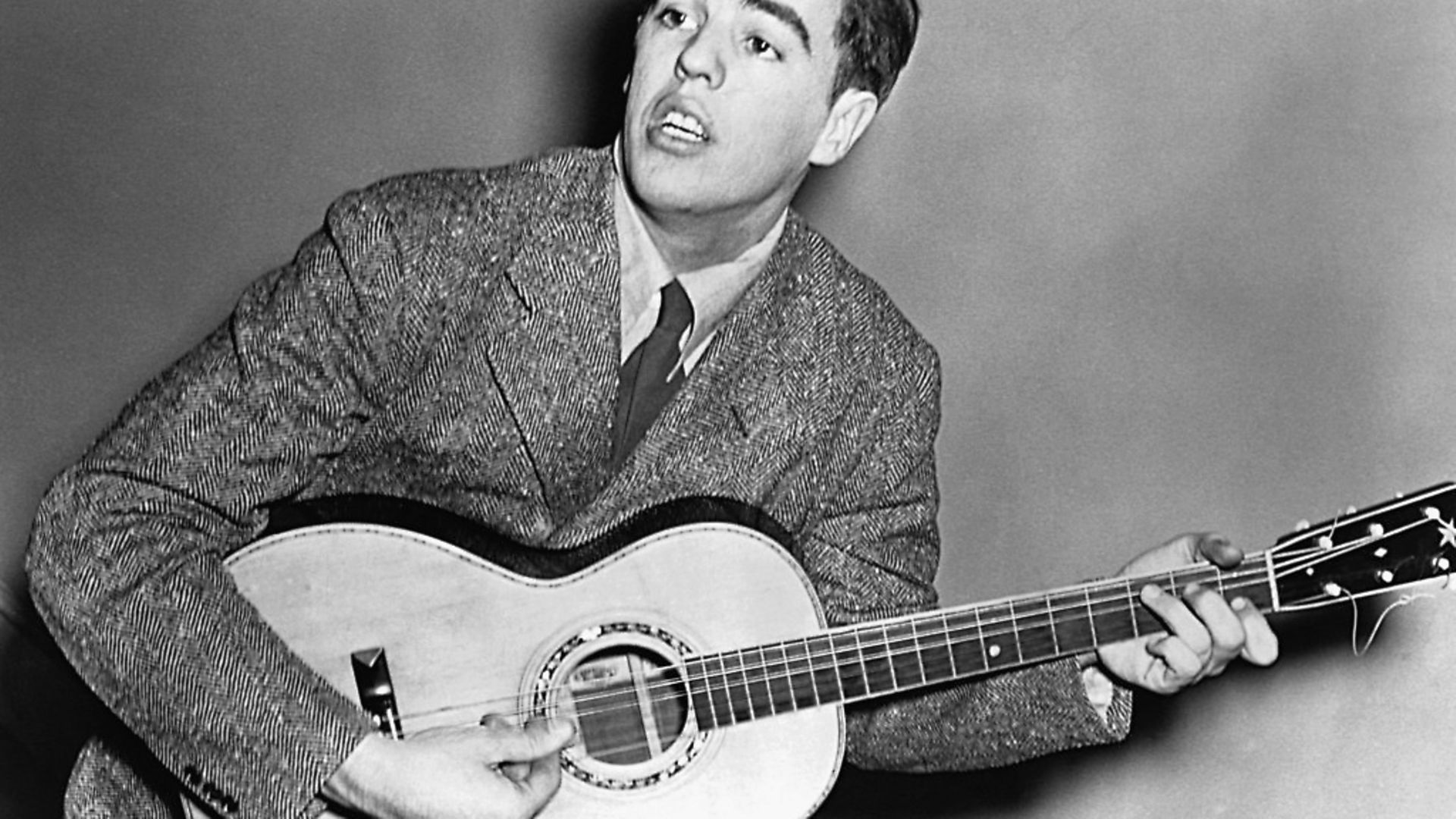 """Singer/songwriter, Alan Lomax joined his father, John Lomax in 1933 and they colloborated in compiling """"American Ballads and Folk Songs"""" and """"Our Singing Country."""" (Photo by © CORBIS/Corbis via Getty Images) - Credit: Corbis via Getty Images"""