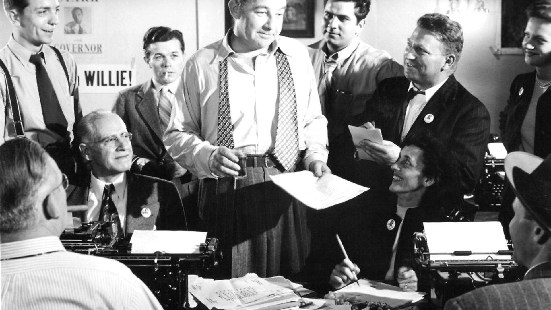 Broderick Crawford standing amongst a group of unknown actors in a scene from the film 'All The Kings Men', 1949.  (Photo by Columbia Pictures/Getty Images) - Credit: Getty Images