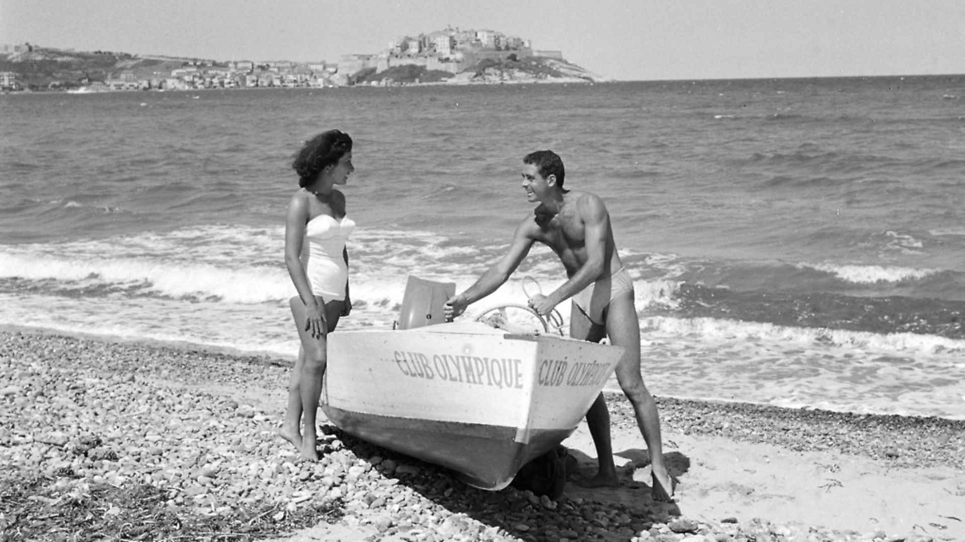 Holidaymakers in Calvi, Sardinia, home of the first package holiday in 1953. Picture: Getty Images - Credit: Paris Match via Getty Images