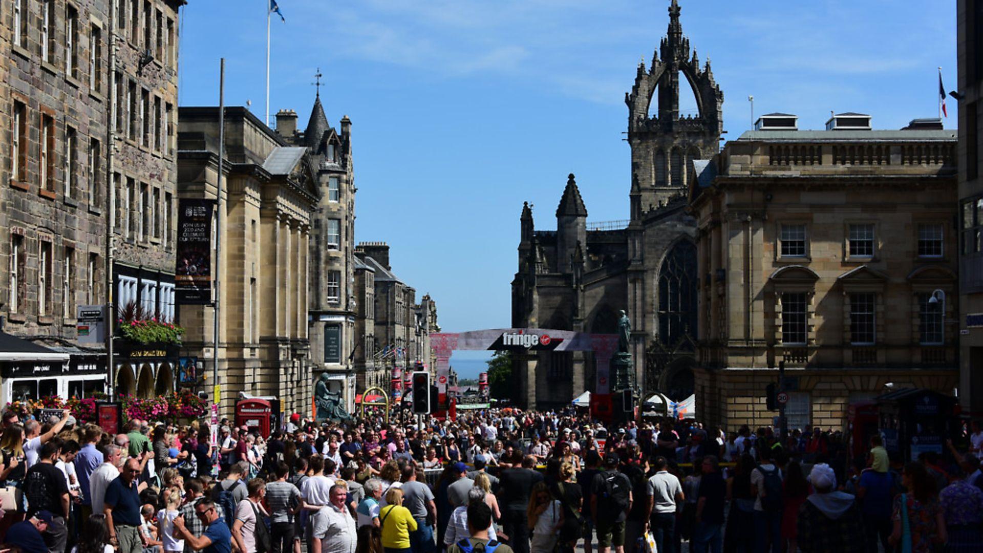 Festival-goers line the Royal Mile at the Edinburgh Festival Fringe. Picture: Ken Jack/Getty Images - Credit: Getty Images