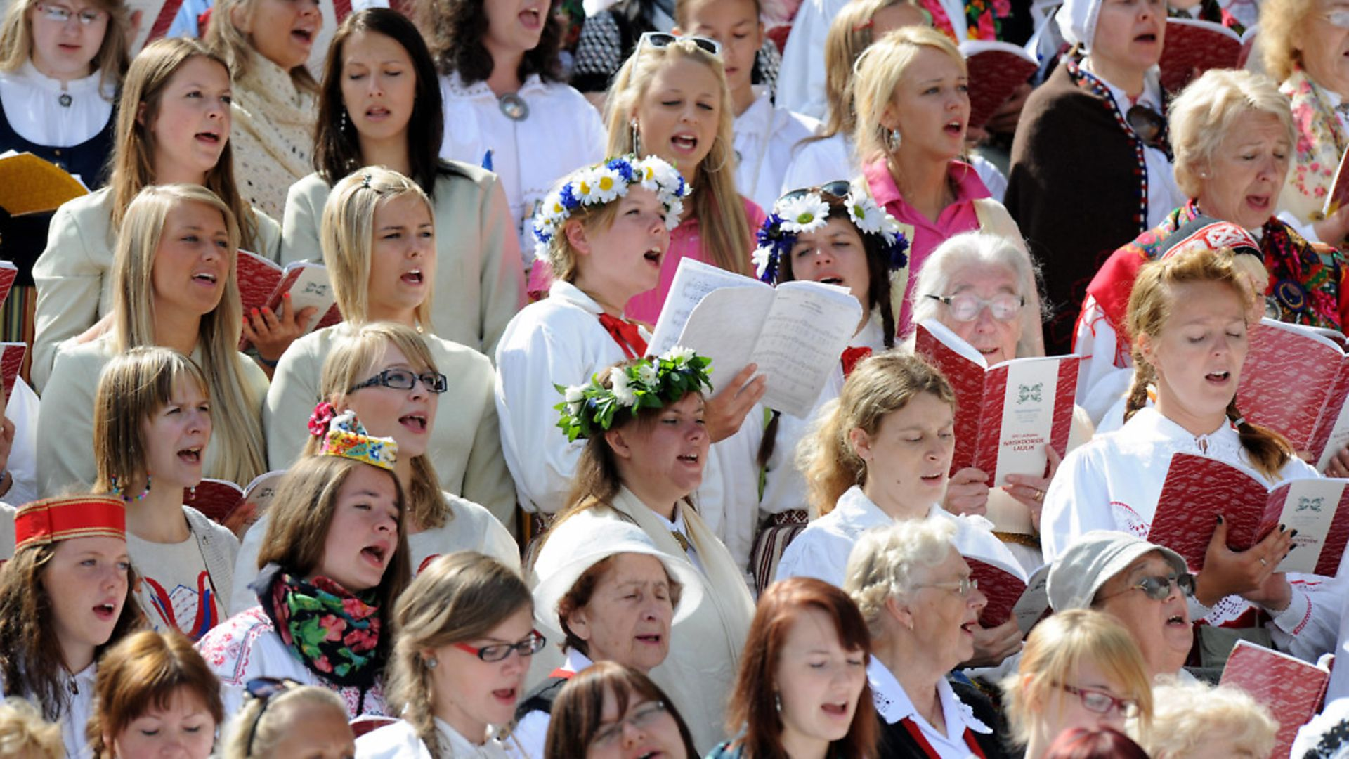 """""""To Breathe as One"""" festival in Tallinn reunits tens of thousands of Estonians that sing in huge choirs over the weekend as the Baltic nations host traditional song and dance festivals. (Photo: RAIGO PAJULA/AFP/Getty Images) - Credit: AFP/Getty Images"""
