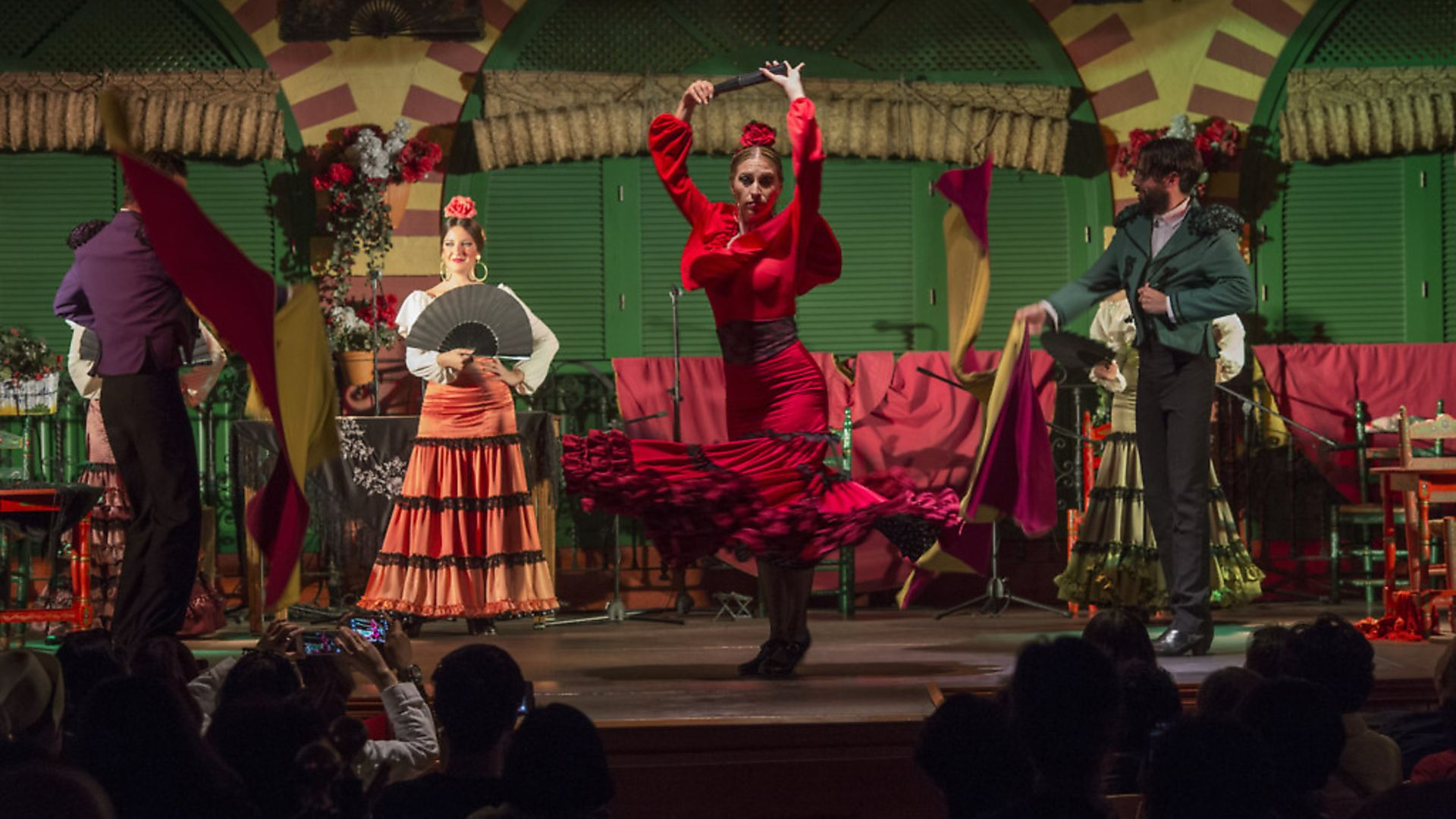 Dancers and musicians performing the Flamenco, a form of Spanish folk music and dance, during a dinner show in Seville, Andalusia, Spain. (Photo by Wolfgang Kaehler/LightRocket via Getty Images) - Credit: LightRocket via Getty Images
