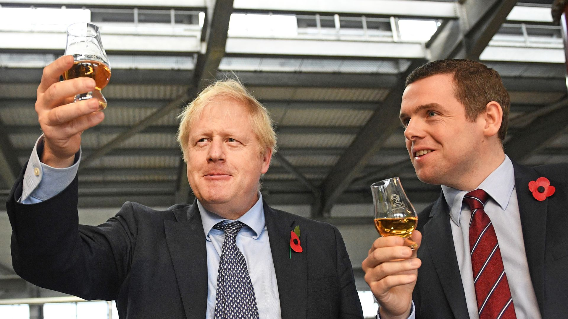 Prime Minister Boris Johnson (left) alongside MP Douglas Ross - Credit: PA