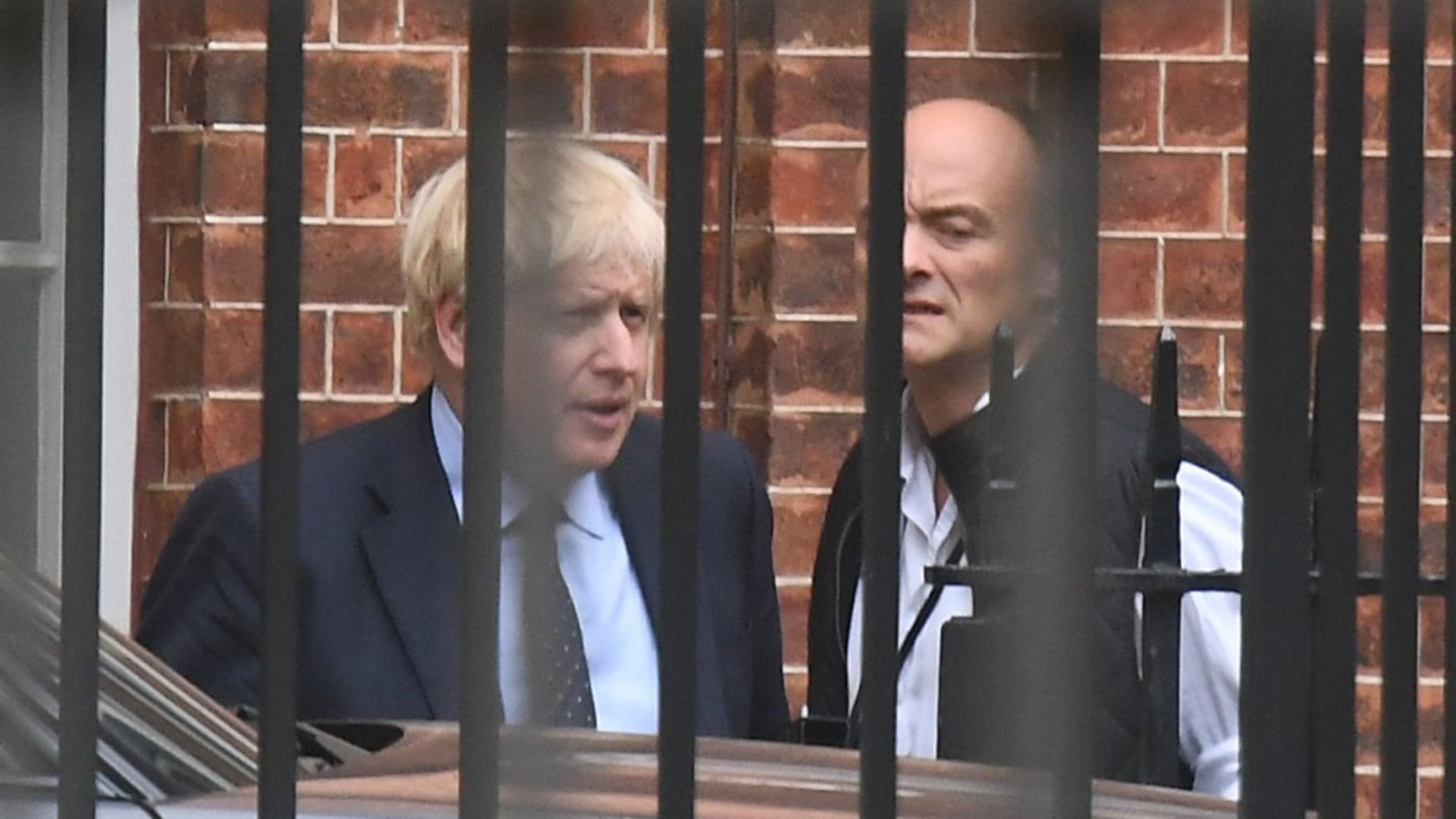 Prime Minister Boris Johnson with his senior aide Dominic Cummings in Downing Street - Credit: PA