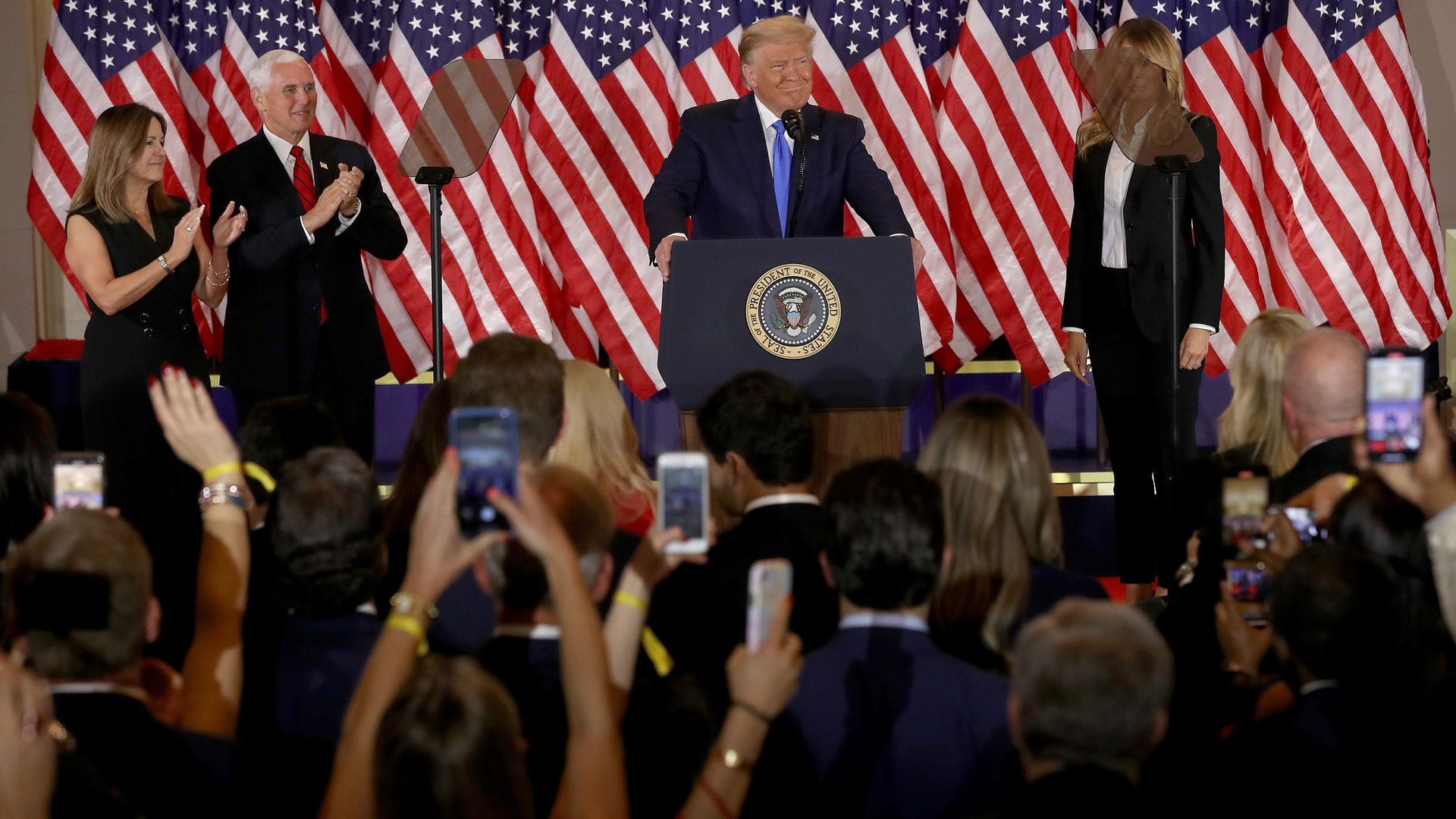 U.S. President Donald Trump speaks on election night in the East Room of the White House as First Lady Melania Trump, Vice President Mike Pence and Karen Pence look on - Credit: Getty Images