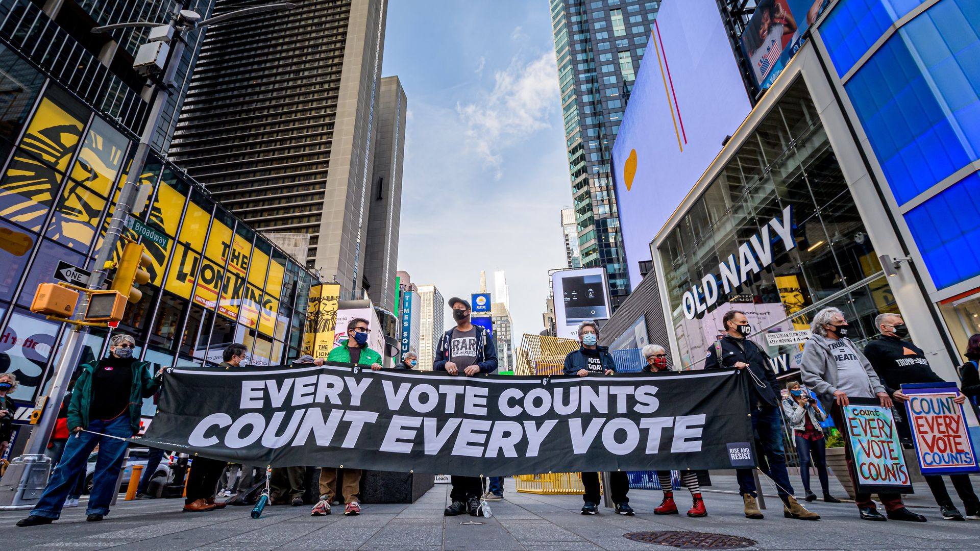 """Participants holding a banner reading: """"EVERY VOTE COUNTS/COUNT EVERY VOTE"""" at the protest in Times Square. - Credit: LightRocket via Getty Images"""