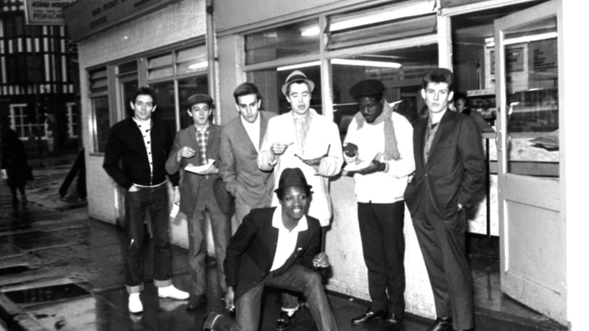 The Specials pop group in chip shop called 'The Parson's Nose' in Bishop Street, Coventry. Photo: John Potter/Mirrorpix/Getty Images - Credit: Getty Images