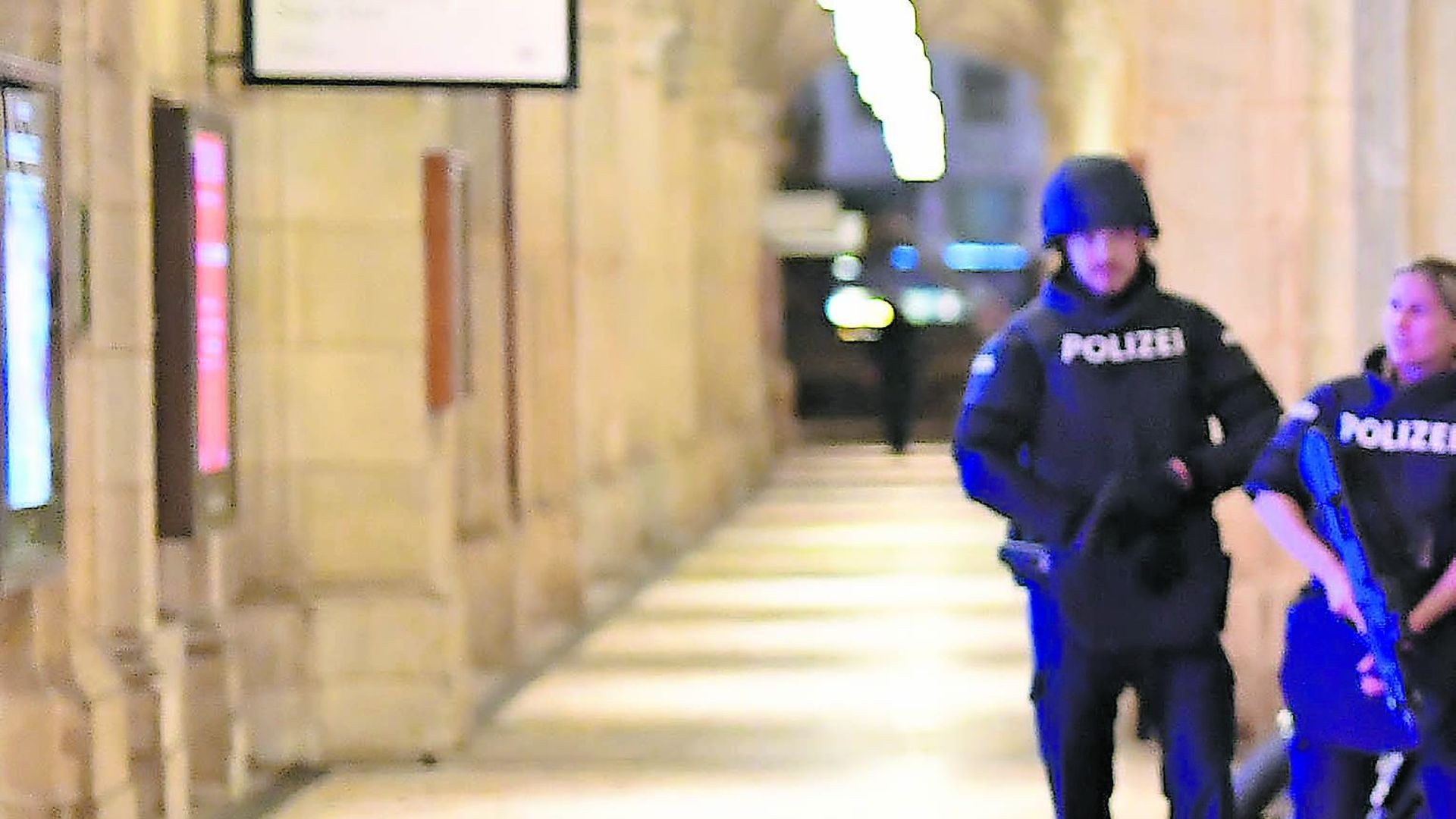 ALERT IN VIENNA: Armed police control a passage near the opera in central Vienna following a shooting near a synagogue - Credit: Getty Images