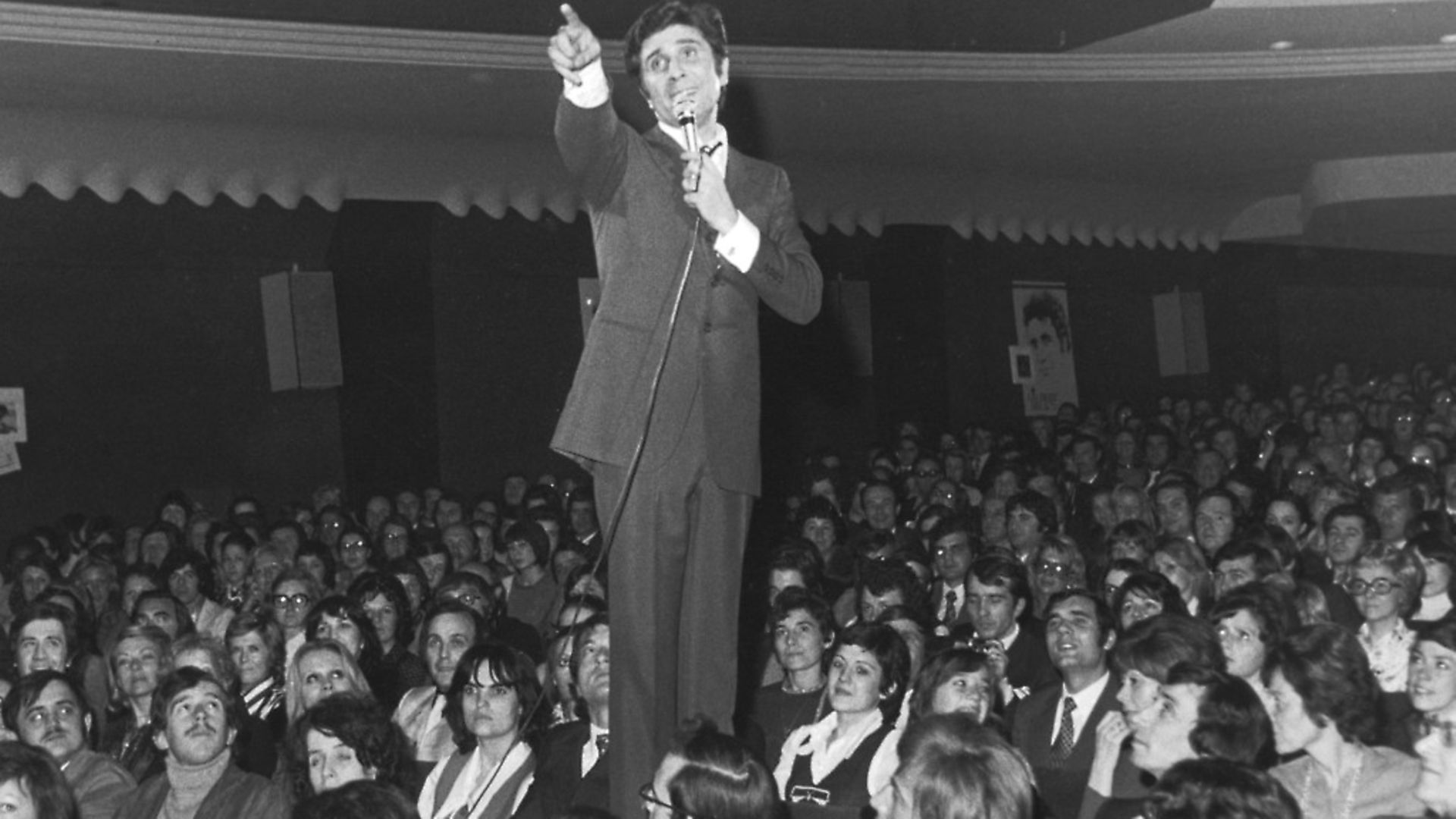 French singer and songwriter Gilbert Becaud (1927 - 2001) among the audience at the Olympia Theatre, Paris, 20th March 1973, during a concert to celebrate his twenty-year career. (Photo by Keystone/Hulton Archive/Getty Images) - Credit: Getty Images