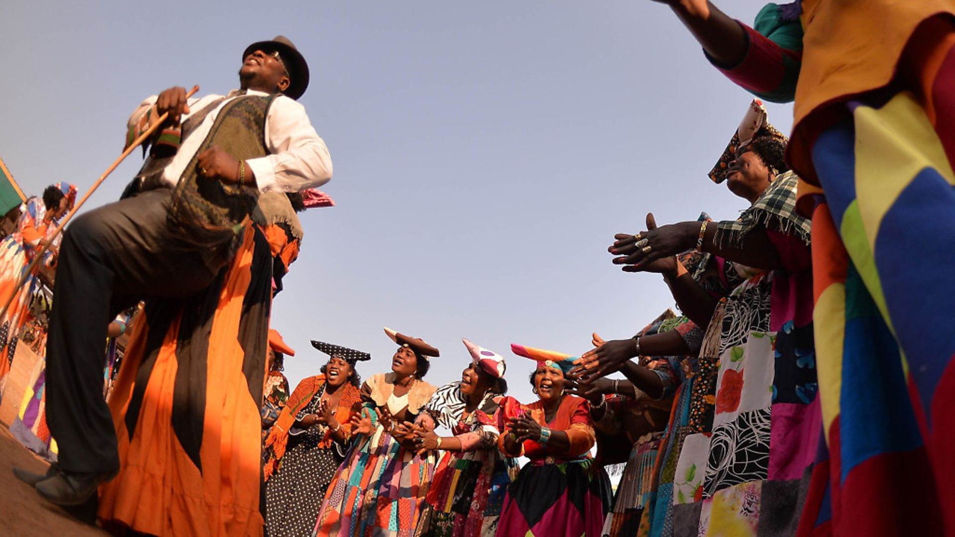 Member of the cultural group Herero perform during the 17th Kuru Festival in Ghanzi, on August 29, 2015. The Kuru festival mainly features the San dance and culture in Botswana. AFP PHOTO/MONIRUL BHUIYAN        (Photo credit should read Monirul Bhuiyan/AFP/Getty Images) - Credit: AFP/Getty Images