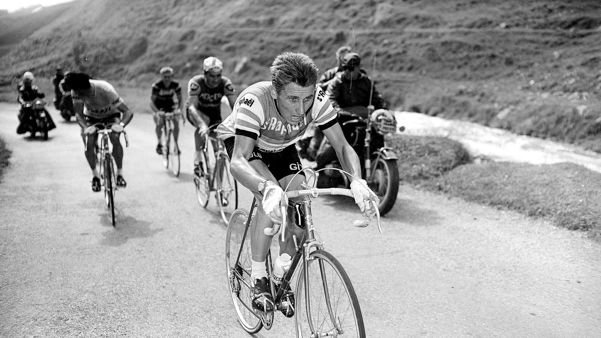 Jacques Anquetil, centre, and rival Raymond Poulidor during one of their Tour de France battles - Credit: Roger Viollet via Getty Images