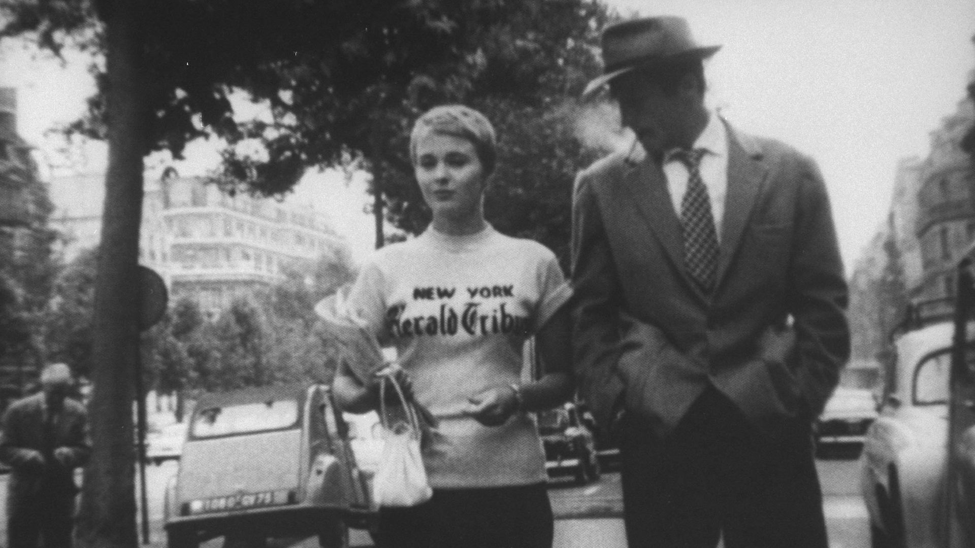 Jean Seberg (L) and Jean-Paul Belmondo in scene from Breathless. - Credit: The LIFE Picture Collection via