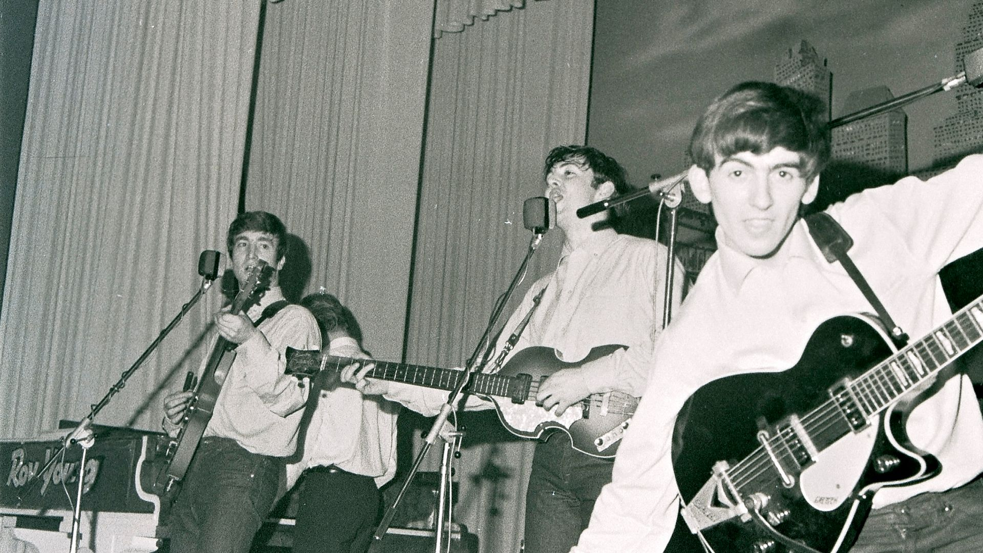 John Lennon, Paul McCartney and George Harrison of the Beatles, at Hamburg's Star-Club, circa May 1962 at the Star-Club in Hamburg, Germany - Credit: Redferns