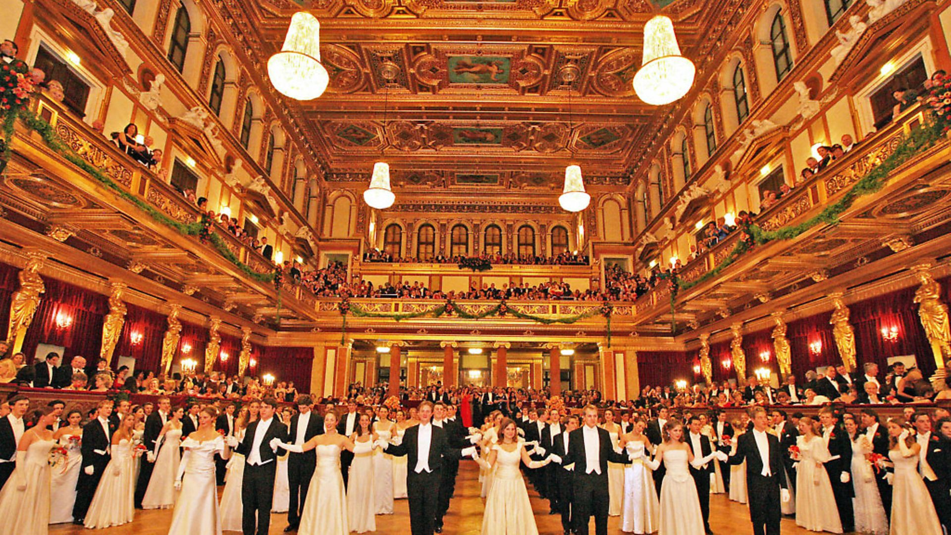 """Young couples wait to dance in the """"Golden Auditorium"""" of the Musikverein on January 22, 2009 during the opening of the Philharmonic Ball, one of the cities fanciest balls of the season, performed by the Vienna Philharmonic Orchestra, in Vienna.     AFP PHOTO/ DIETER NAGL (Photo credit should read DIETER NAGL/AFP via Getty Images) - Credit: AFP via Getty Images"""
