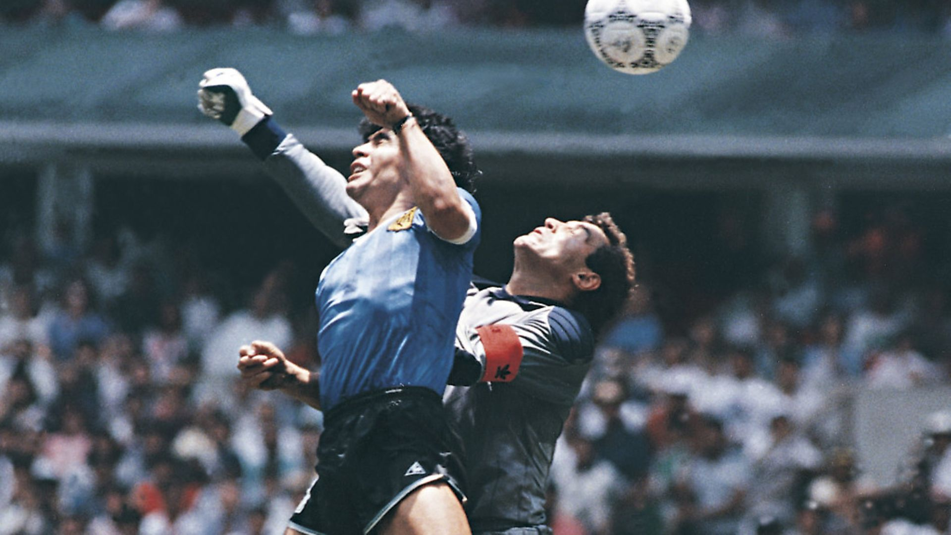 MEXICO CITY, MEXICO - JUNE 22: Diego Maradona of Argentina uses his hand to score the first goal of his team during a 1986 FIFA World Cup Quarter Final match between Argentina and England at Azteca Stadium on June 22, 1986 in Mexico City, Mexico. Maradona later claimed that the goal was scored by 'The Hand Of God'. (Photo by Archivo El Grafico/Getty Images) - Credit: Getty Images