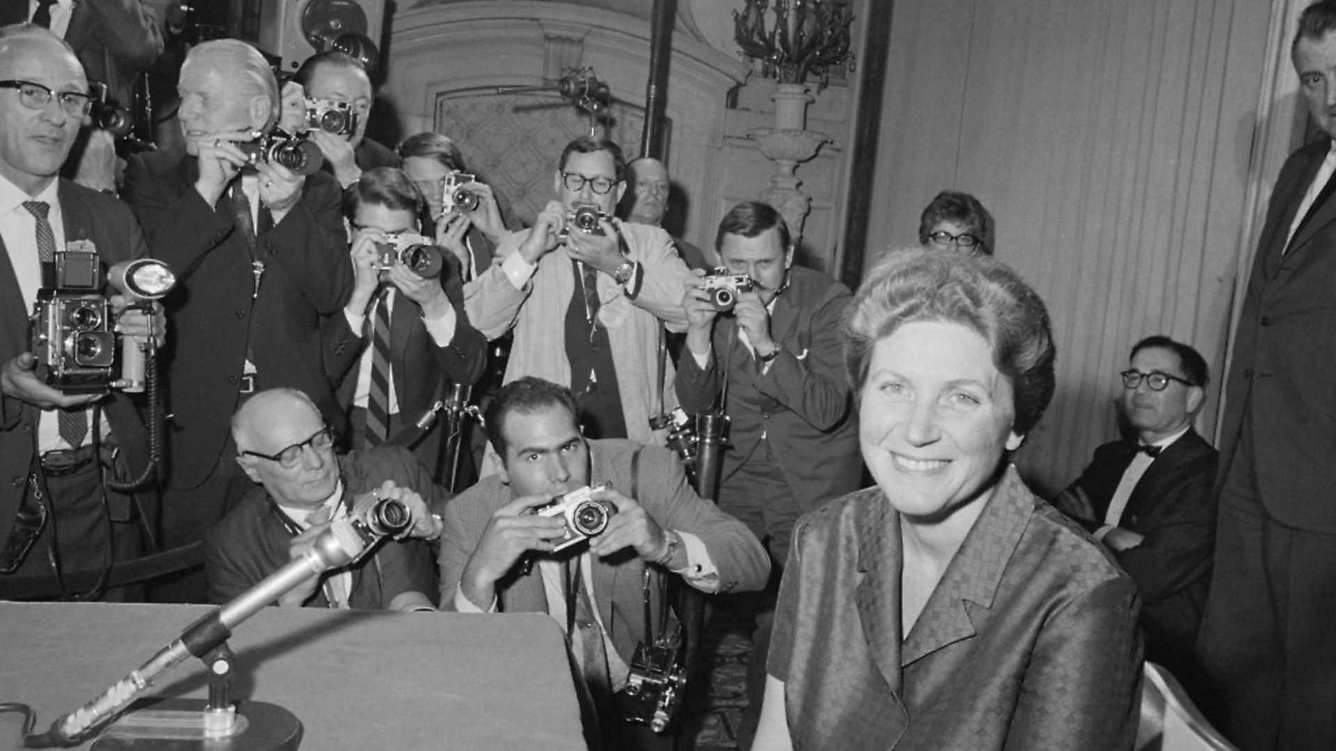 (Original Caption) Say Cheese. New York: Svetlana Alliluyeva, daughter of the late Russian dictator, Josef Stalin, smiles for photographers at her press conference here April 26. - Credit: Bettmann Archive