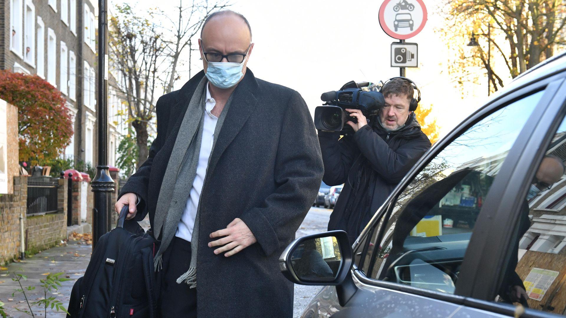 Prime minister Boris Johnson's top aide Dominic Cummings leaving his north London home - Credit: PA