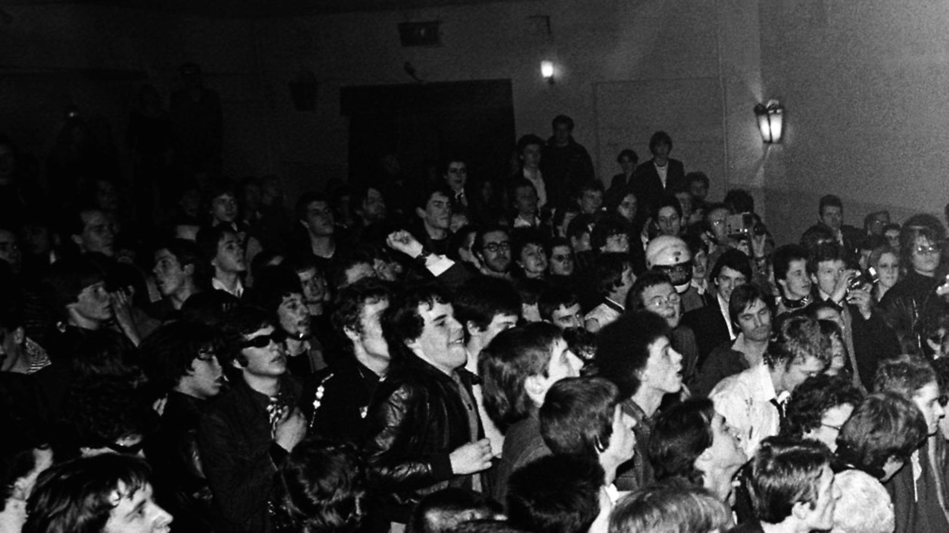 Photo of Paul SIMONON and Joe STRUMMER and CLASH; Joe Strummer and Paul Simonon (jumping) performing live onstage in small venue, showing crowds  (Photo by Ian Dickson/Redferns) - Credit: Redferns