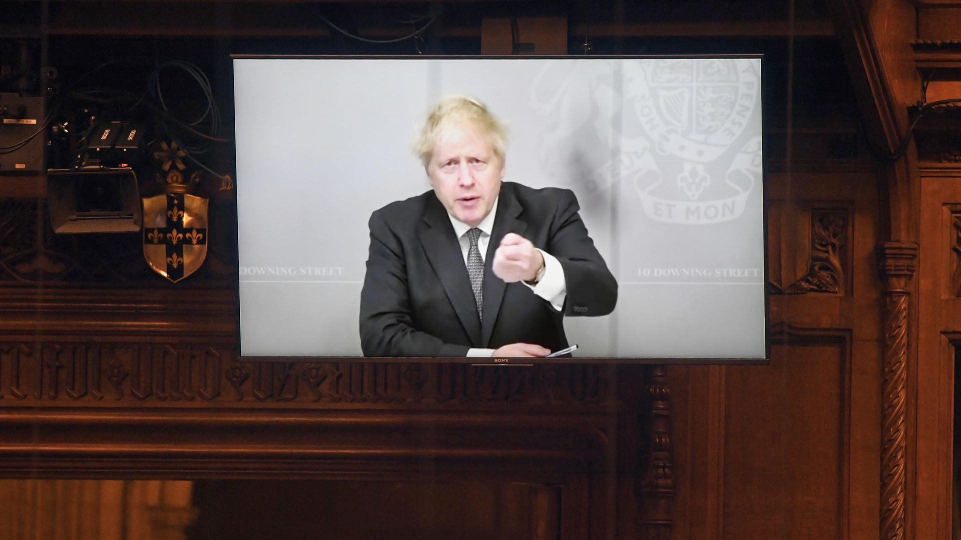 Prime Minister Boris Johnson appearing via video link from 10 Downing Street during Prime Minister's Questions in the House of Commons - Credit: PA