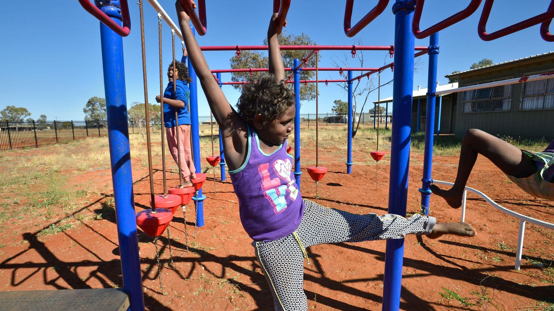 Schoolchildren play in the Anangu Pitjantjatjara Yankunytjatjara lands, in South Australia, where Pitjantjatjara is spoken - Credit: Fairfax Media via Getty Images