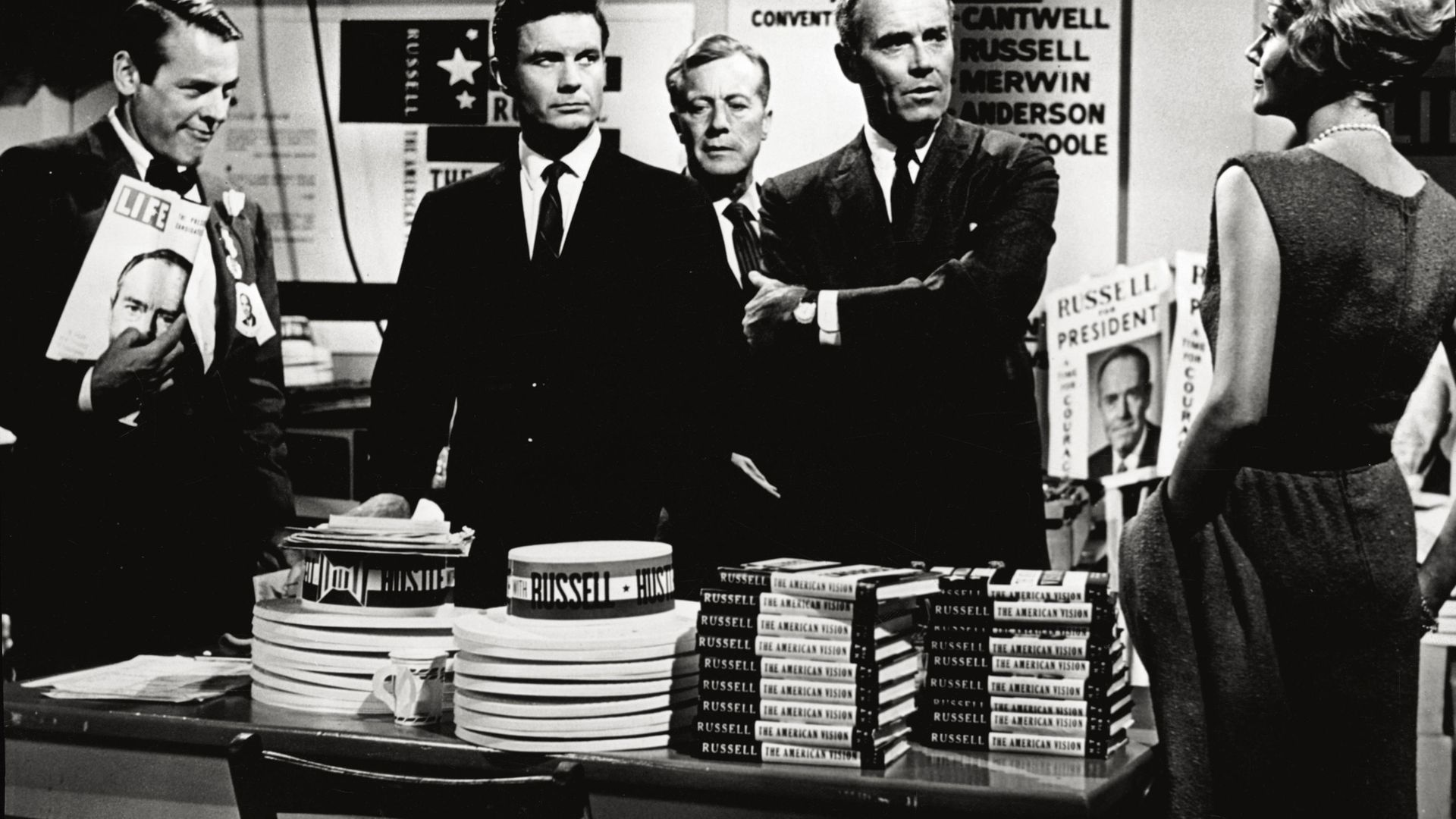 Cliff Robertson (the second from the left) and Henry Fonda (with his arms folded) play the role of two politicians running for the Presidency of the United States in the film 'The Best Man' - Credit: Mondadori via Getty Images