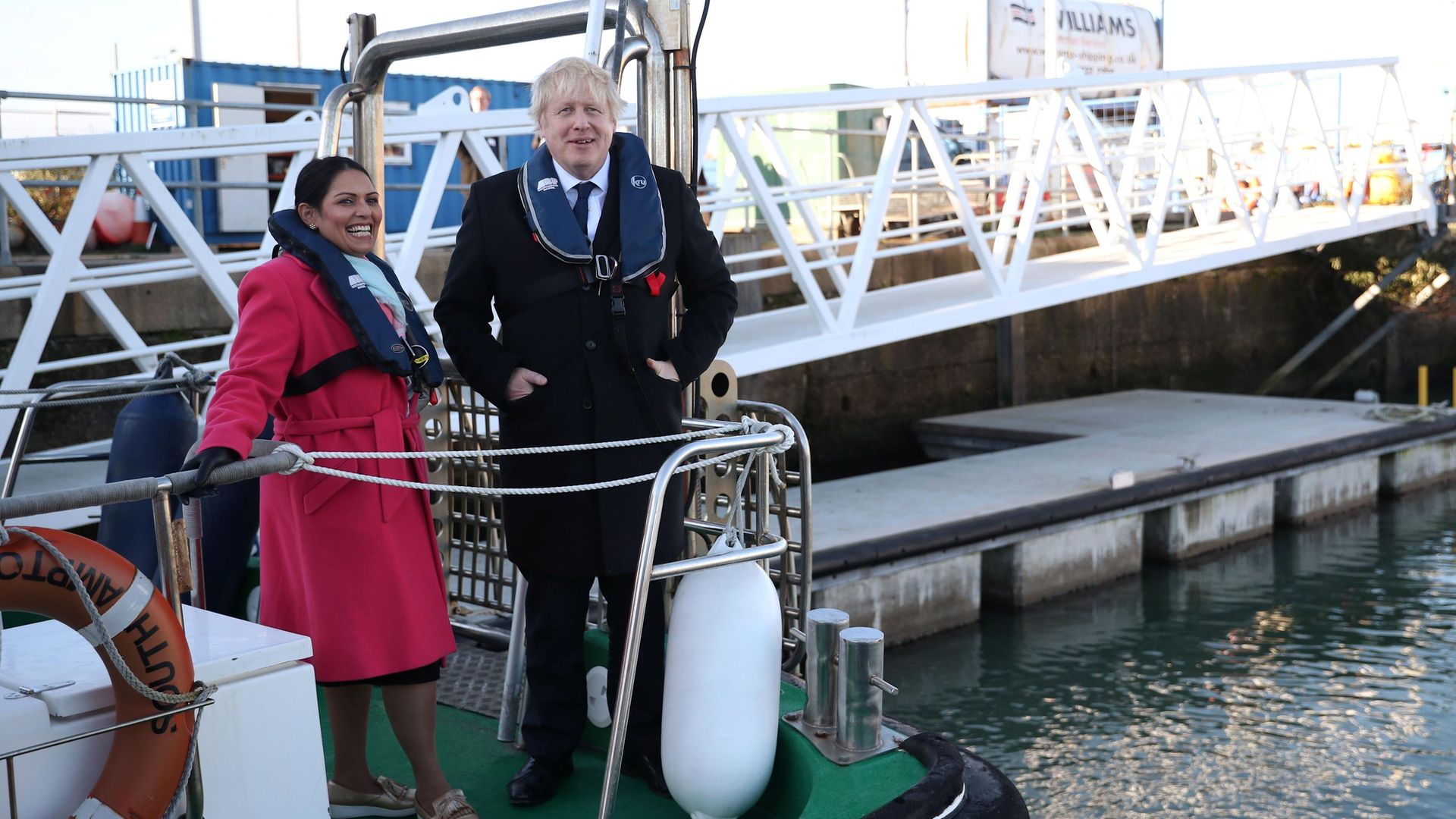 Boris Johnson and Priti Patel on a boat at Southampton docks during the 2019 election campaign - Credit: POOL/AFP via Getty Images