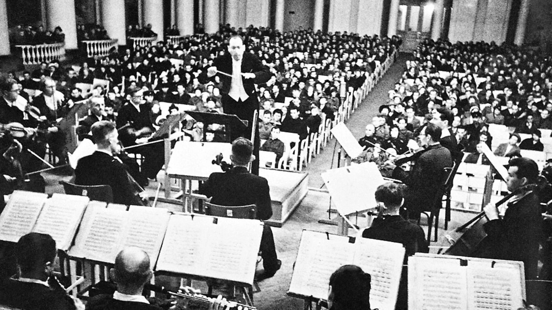 Conductor Karl Eliasberg leading the Saint Petersburg Philharmonic Orchestra as they perform Seventh Symphony by Dmitri Shostakovich during the siege of Leningrad. Picture: TASS via Getty Images - Credit: TASS via Getty Images