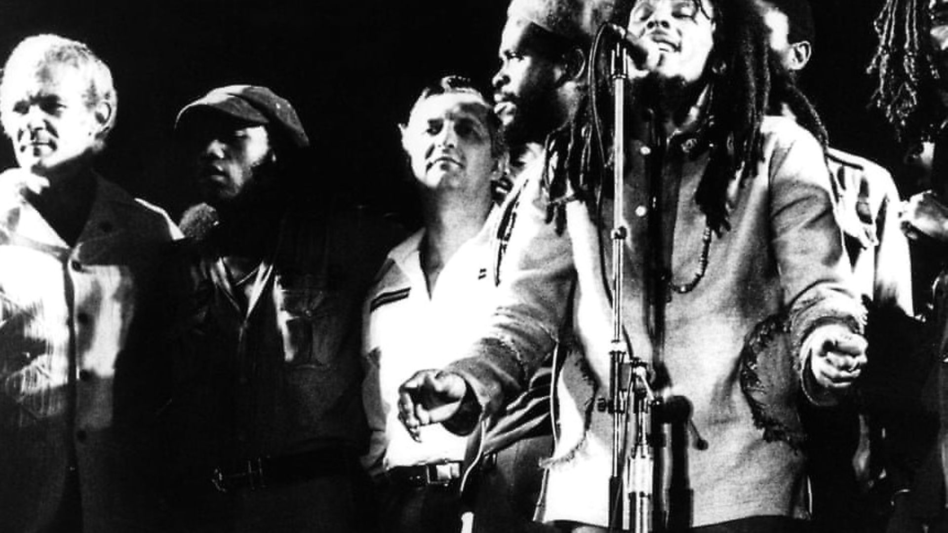 Bob Marley brought together the Jamaican prime minister Michael Manley (far left) and his political opponent Edward Seaga (third from left), together for a show of unity on stage at the 1978 One Love Peace concert in Kingston, Jamaica. Photograph: Echoes/Redferns - Credit: Archant