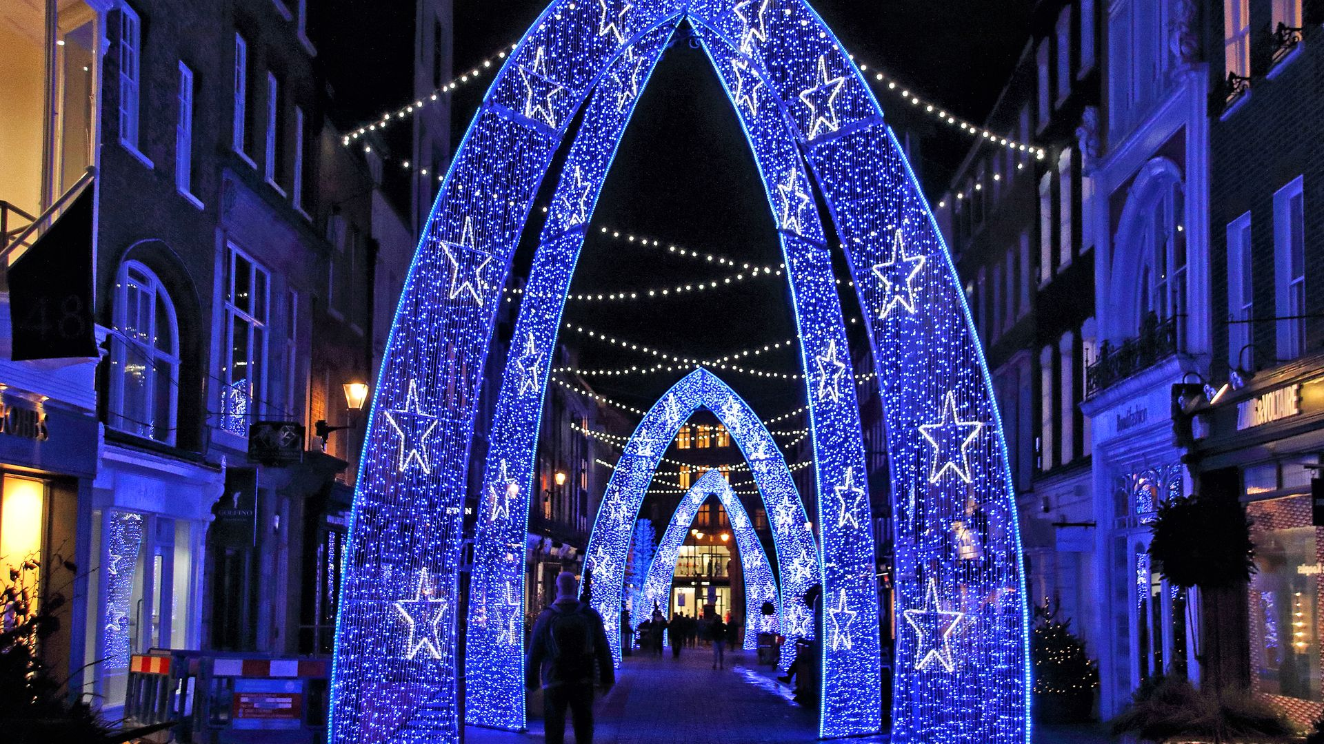 A display of Christmas lights in an almost deserted South Molton Street, in London - Credit: SOPA Images/LightRocket via Gett