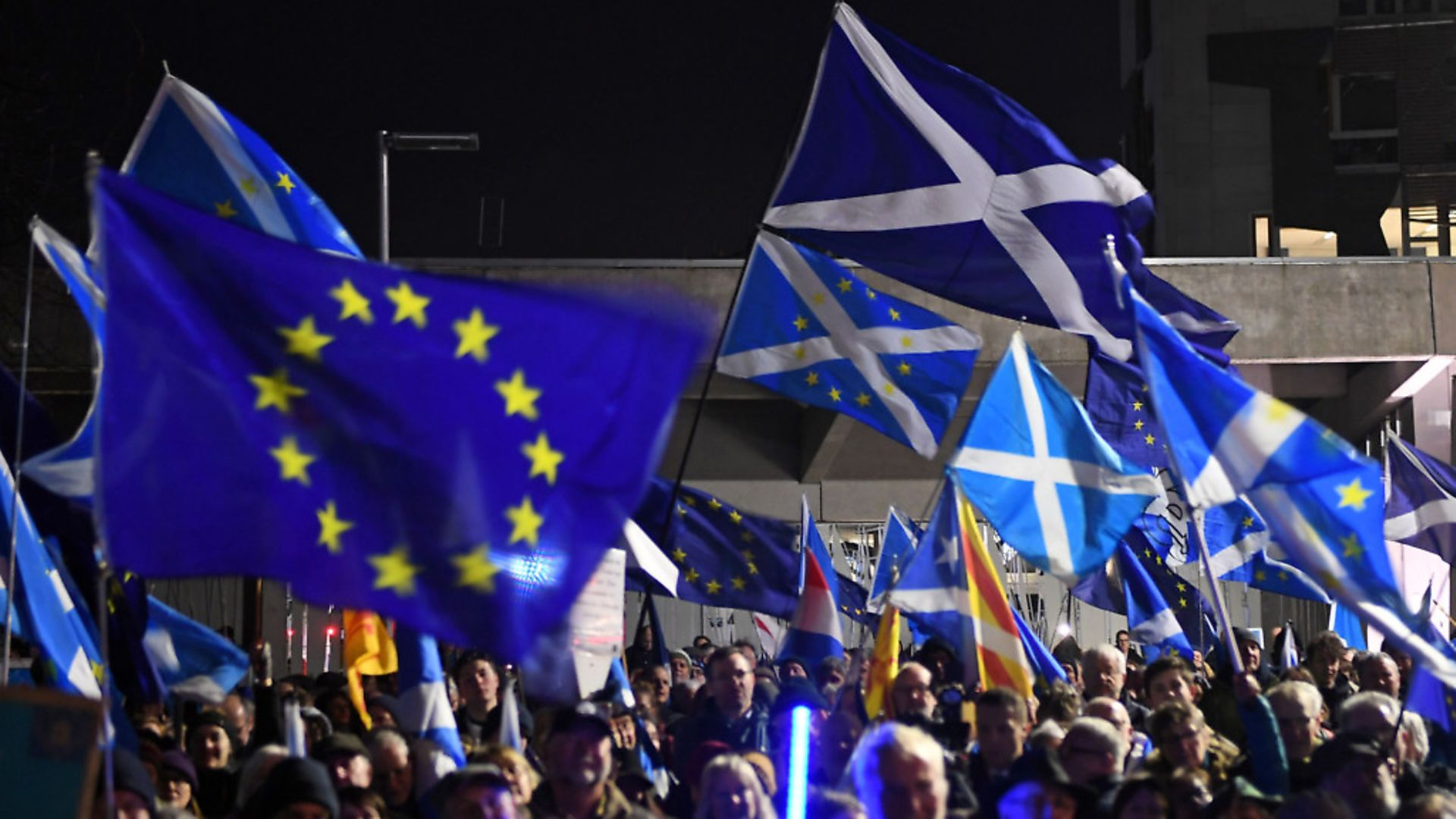 Saltires and European Union flags flutter in the breeze during a protest by anti-Brexit activists in Edinburgh, Scotland on January 31, 2020. Photo: ANDY BUCHANAN/AFP via Getty Images - Credit: AFP via Getty Images