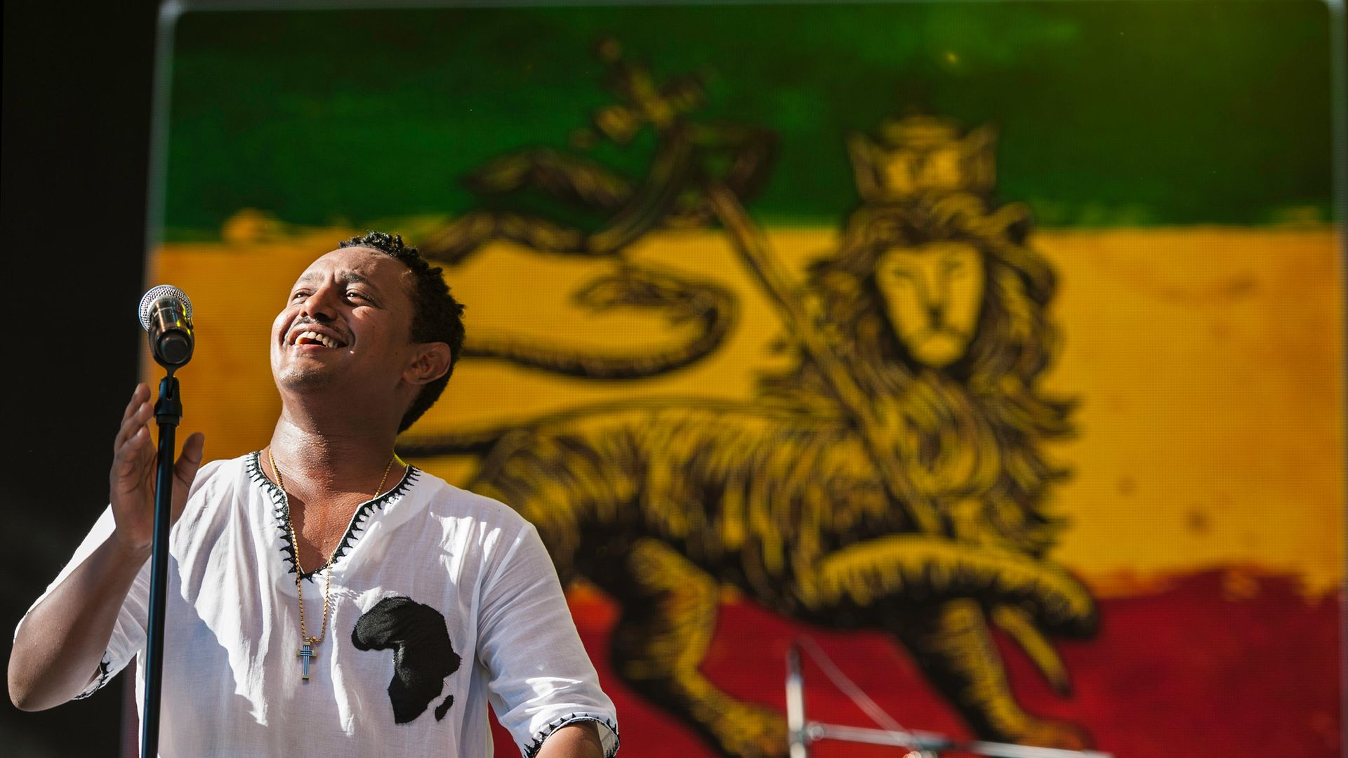 Teddy Afro performs on stage at a concert in Central Park, New York, in 2014 - Credit: Getty Images