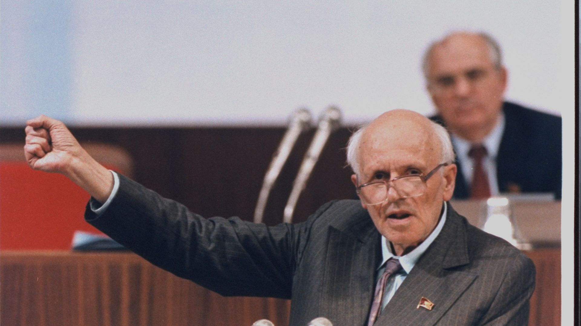 Andrei Sakharov, a few days before his death, during a session of the Congress of People's Deputies, with Mikhail Gorbachev listening behind - Credit: The LIFE Images Collection via G