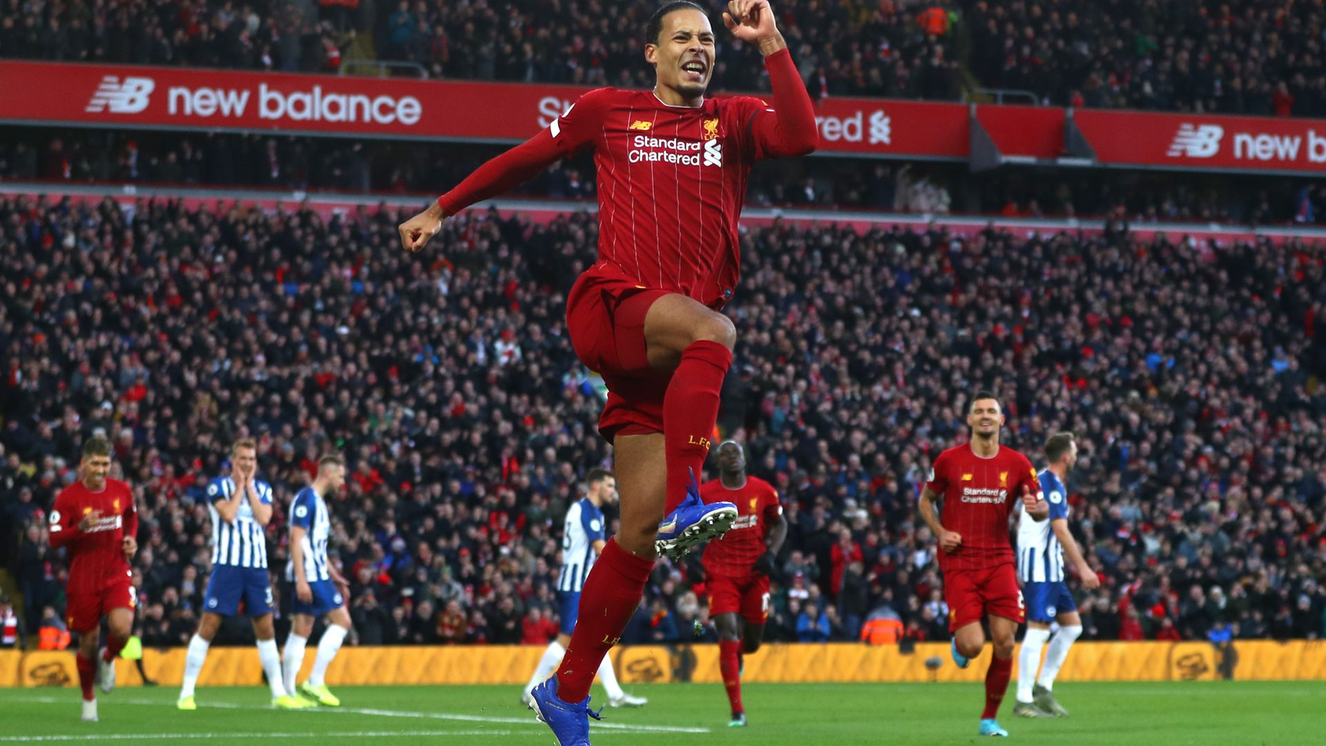 Liverpool's Virgil Van Dijk celebrating a goal against Brighton and Hove Albion. Would he have been able to play in England under rules about to be introduced? - Credit: Getty Images