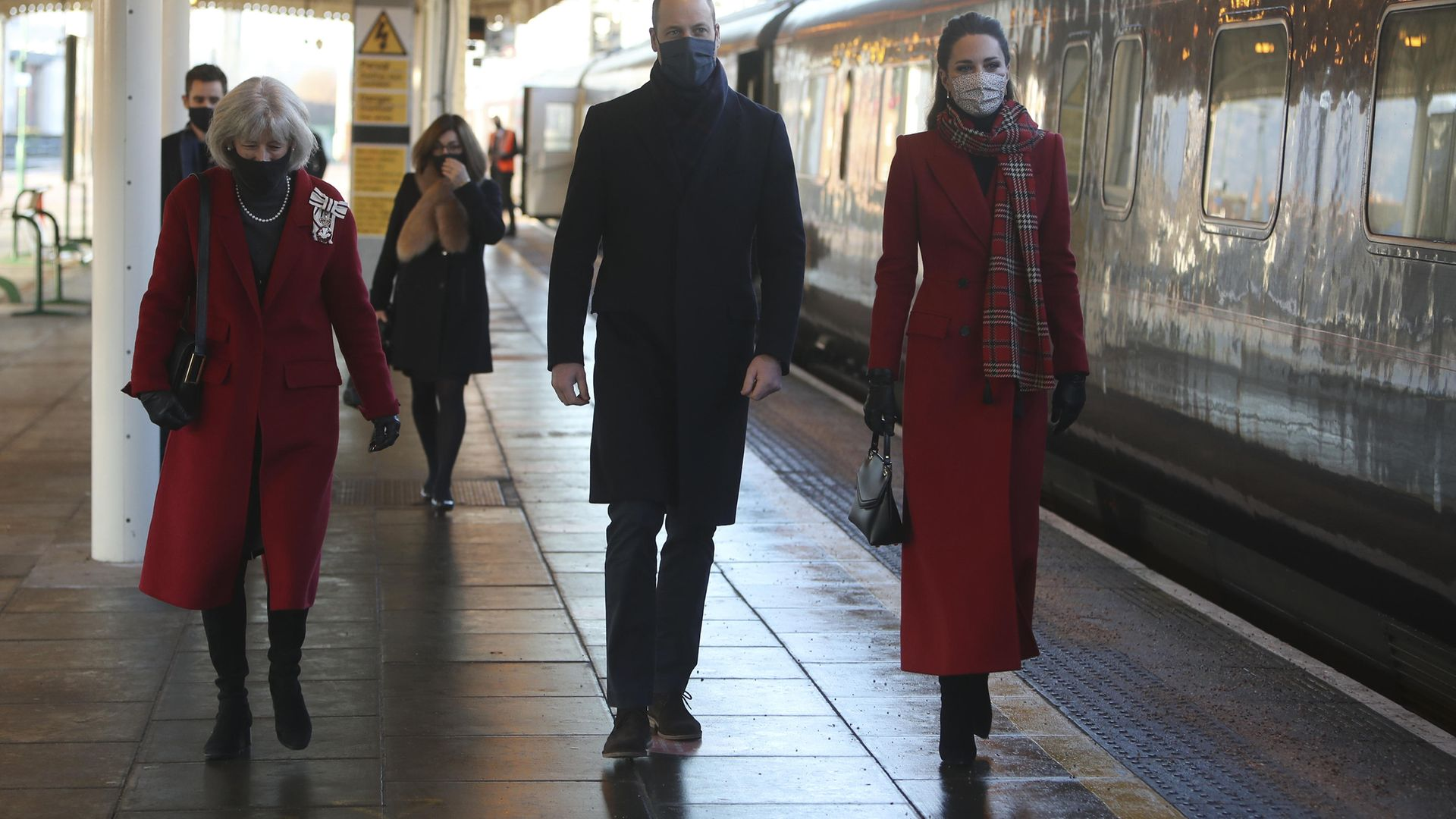 The Duke and Duchess of Cambridge walk with Lord Lieutenant of South Glamorgan Morfudd Meredith (left) as they arrive at Cardiff Central train station on the final day of a three-day tour across the country. - Credit: PA