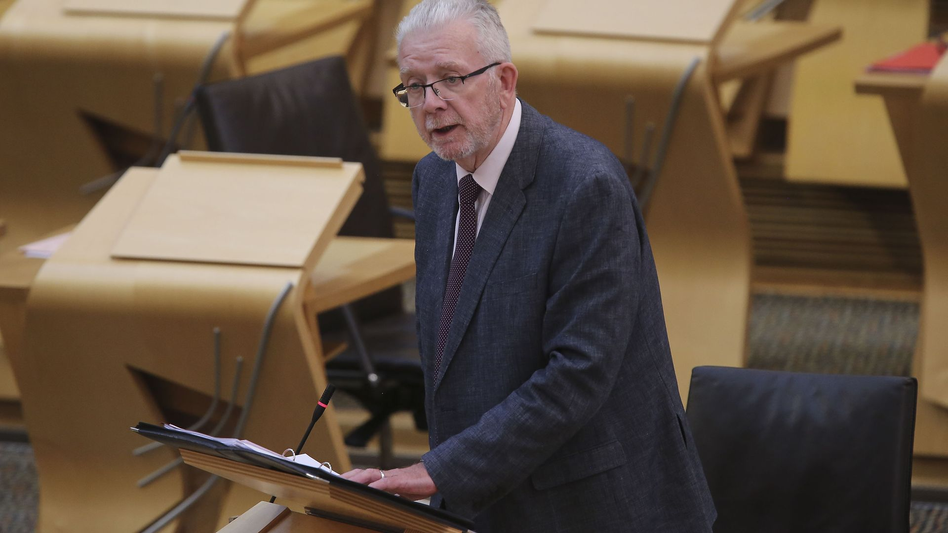 Cabinet Secretary for Government Business and Constitutional Relations Michael Russell giving a ministerial statement at the Scottish Parliament at Holyrood, Edinburgh. - Credit: PA