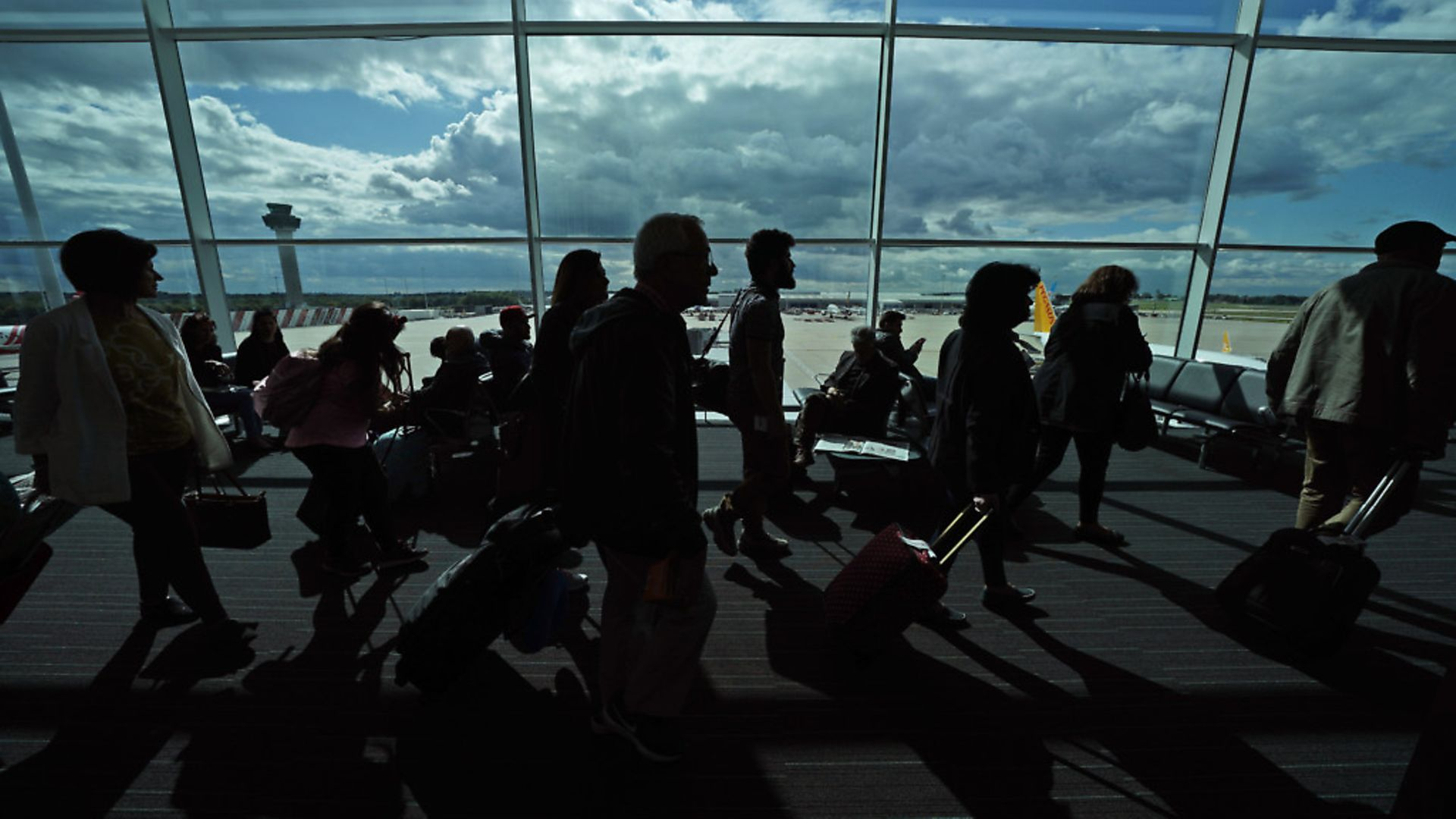 Passengers waiting in a departure lounge at London Stansted Airport. Photograph: Yui Mok/PA. - Credit: PA Archive/PA Images