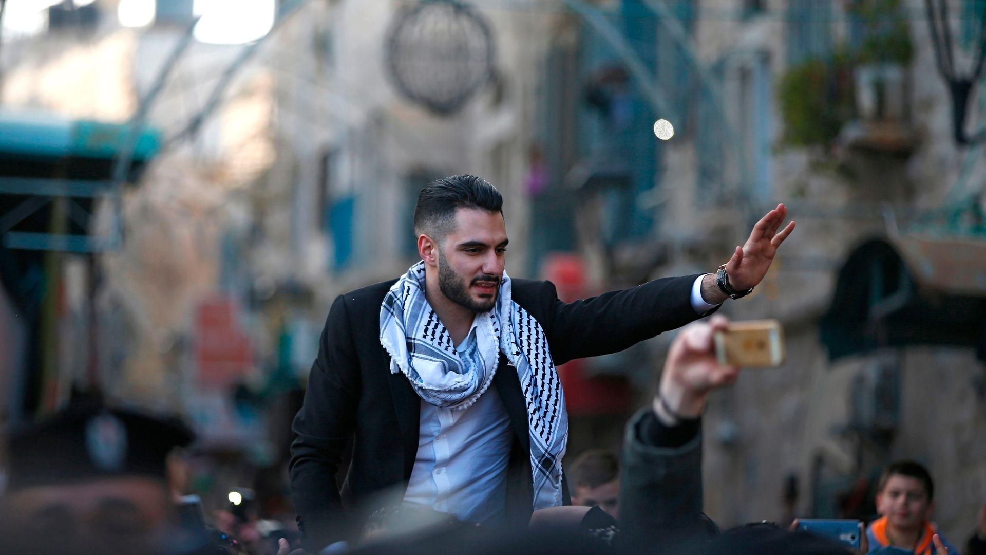 Yacoub Shaheen is greeted by crowds in his hometown of Bethlehem after winning Arab Idol in 2017 - Credit: AFP via Getty Images