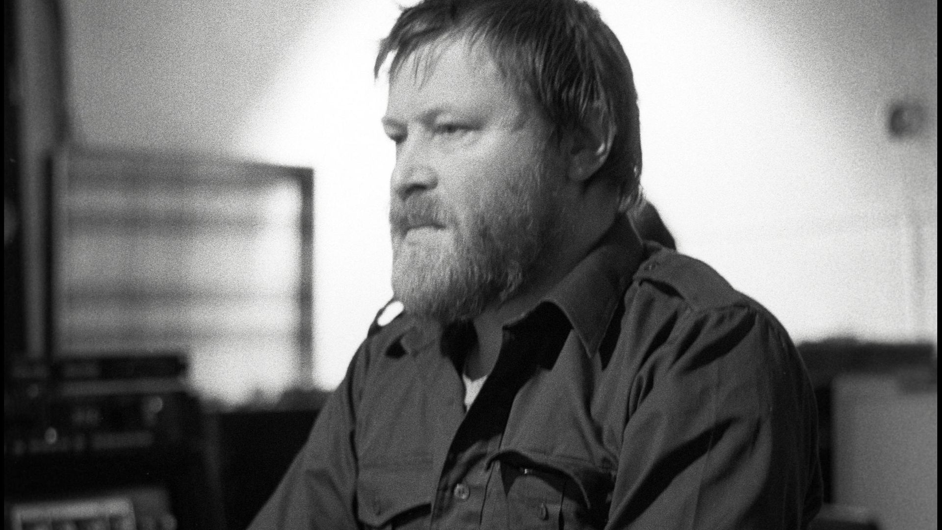 Conny Plank at work by the mixing desk in the control room of his recording studio at Wolperath in 1982 - Credit: Redferns