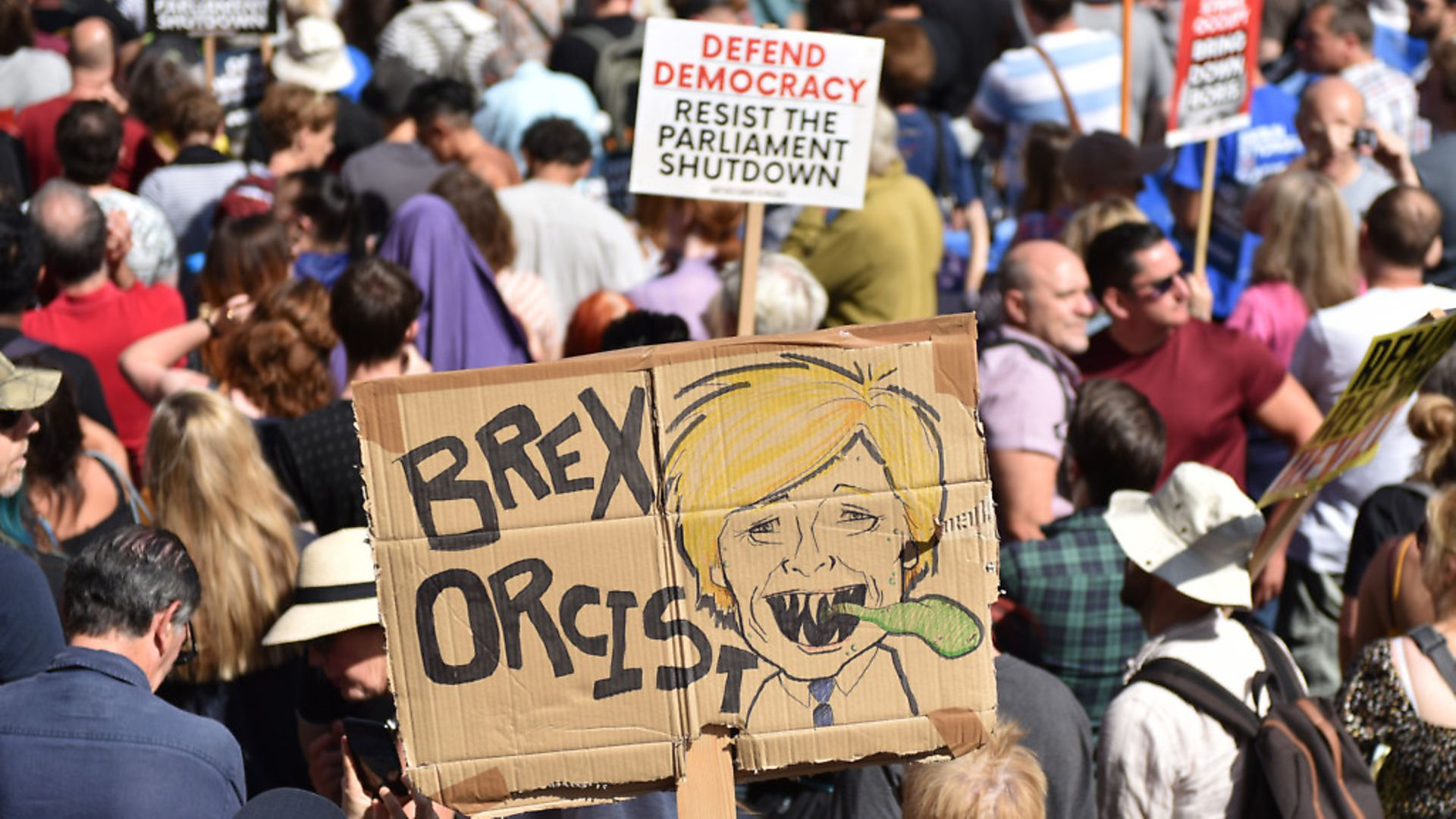 """A protester holds a placard of Boris Johnson with the words """"Brex Orcist"""" outside Downing Street for the """"Stop The Coup"""" protests. (Photo by John Keeble/Getty Images) - Credit: Getty Images"""