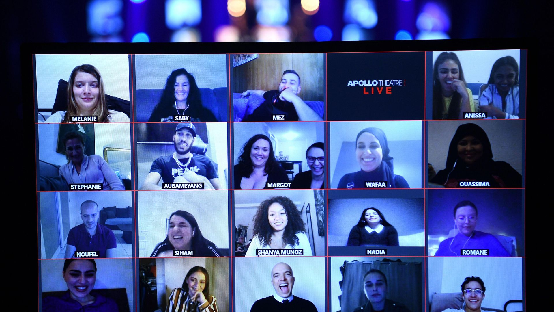 Viewers watch the live streaming of French humorists Othman and Kalvin at the Apollo Theatre in Paris - Credit: AFP via Getty Images