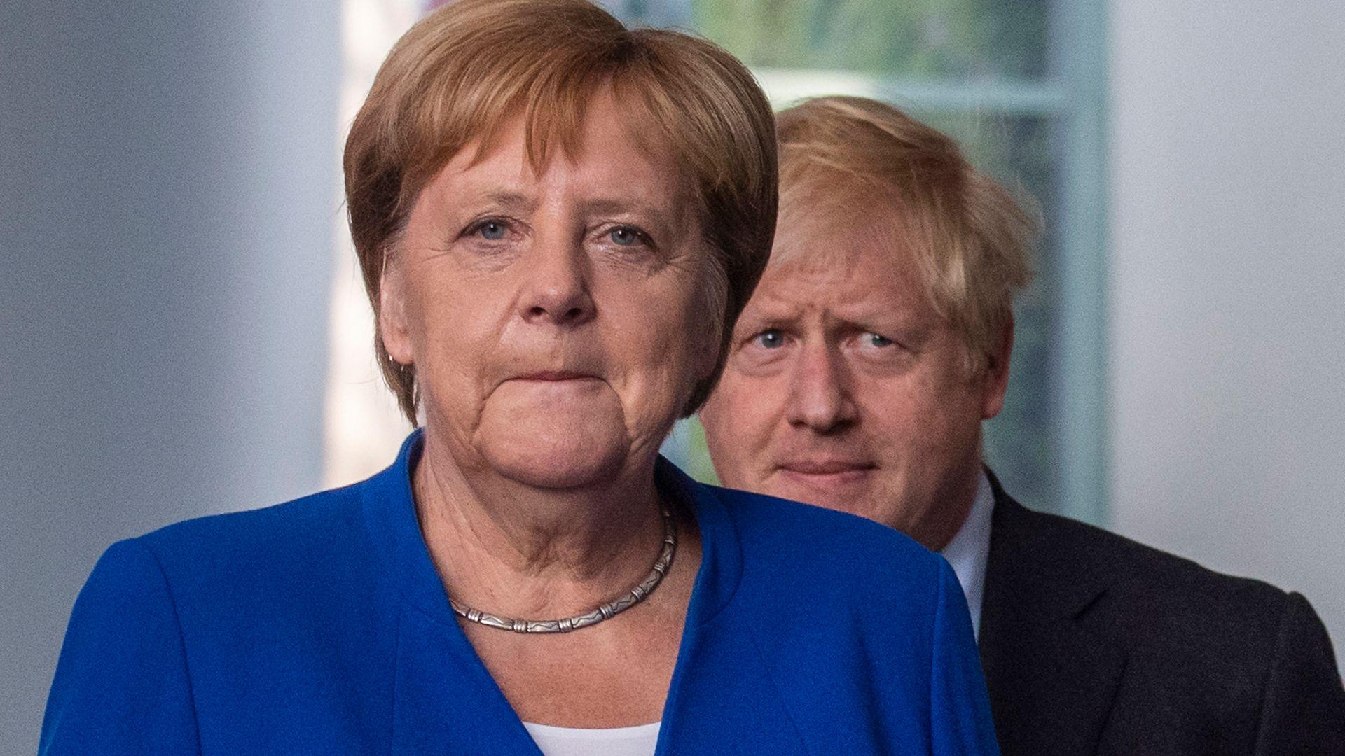 Angela Merkel and Boris Johnson in 2019 in Berlin - Credit: AFP via Getty Images