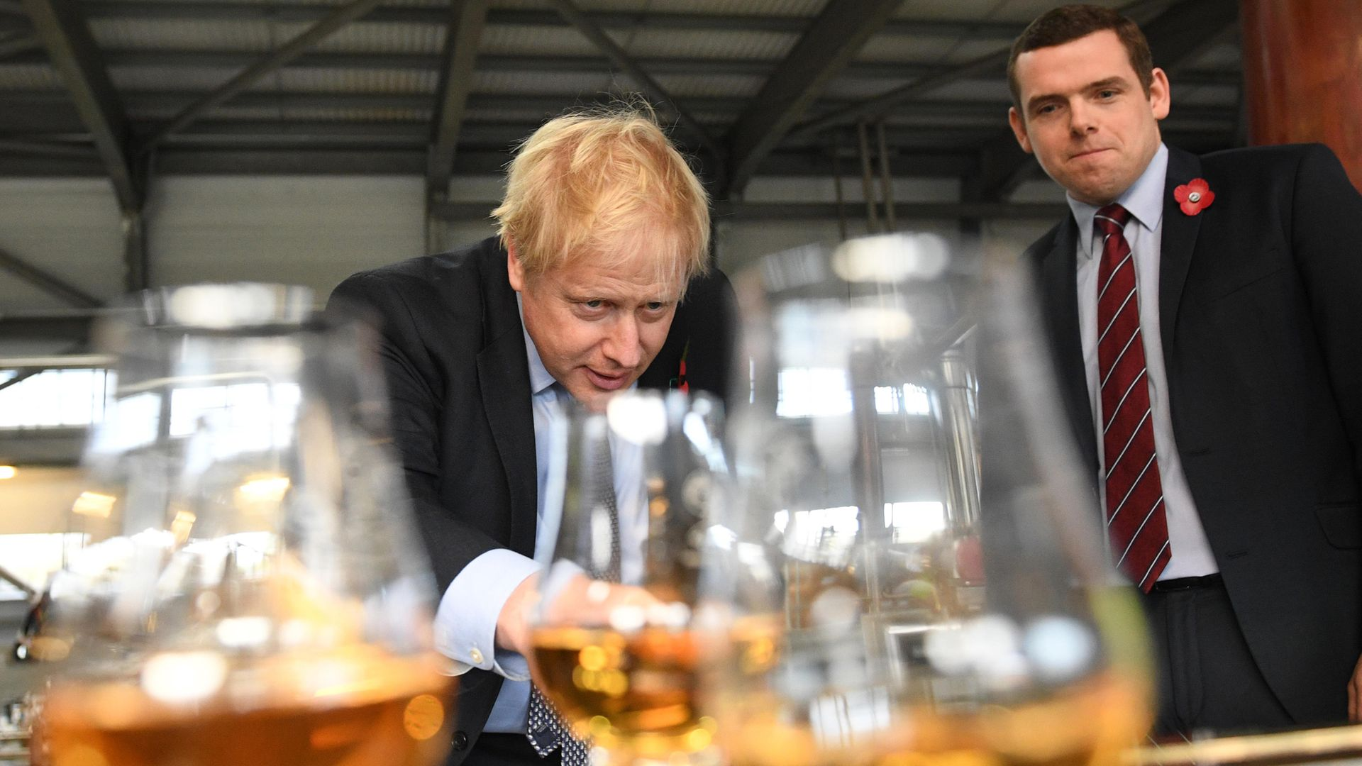 Prime minister Boris Johnson tastes whisky at the Roseisle Distillery in Scotland near Moray with Douglas Ross, leader of the Scottish Conservative Party MP (right) - Credit: PA