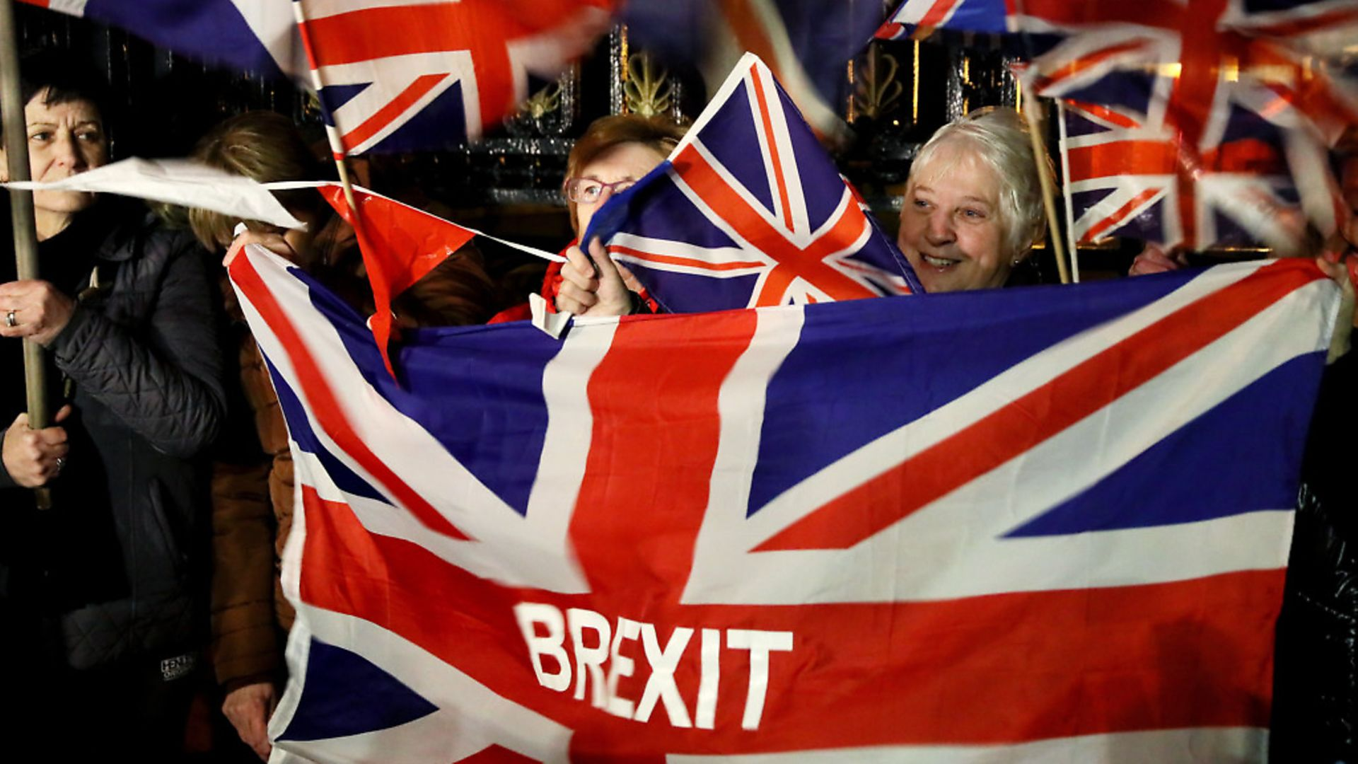 Pro-Brexit supporters gather to celebrate as the UK prepares to leave the European Union. Photograph: United Kingdom/PA. - Credit: PA