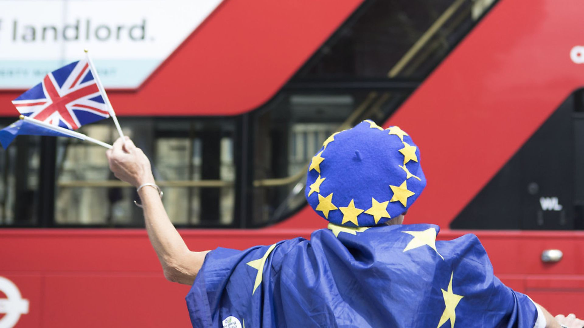 Anti-Brexit demonstrators wave European and Union flags outside the Houses of Parliament in London. Photograph: Rick Findler/PA. - Credit: PA Archive/PA Images