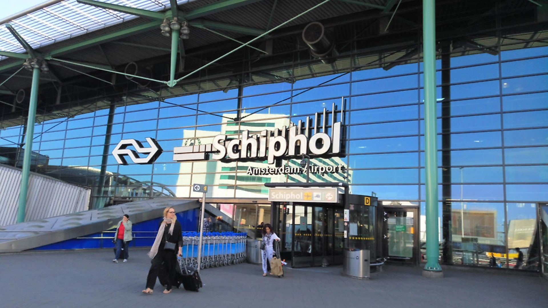 At Amsterdam's Schiphol airport, passengers are often told to 'keep' passports ready. Why do British airports say 'have'? Photo: Wikicommons - Credit: Archant