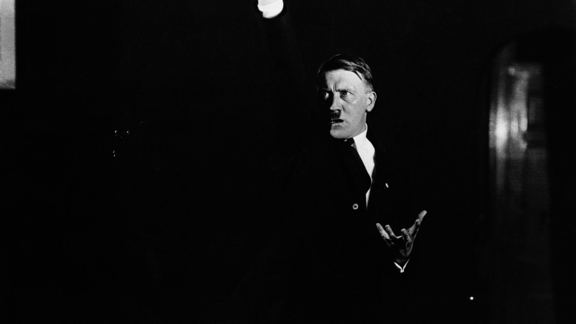 Hitler practices his speech making in front of a photographer so he can study the dramatic impact - Credit: Corbis via Getty Images