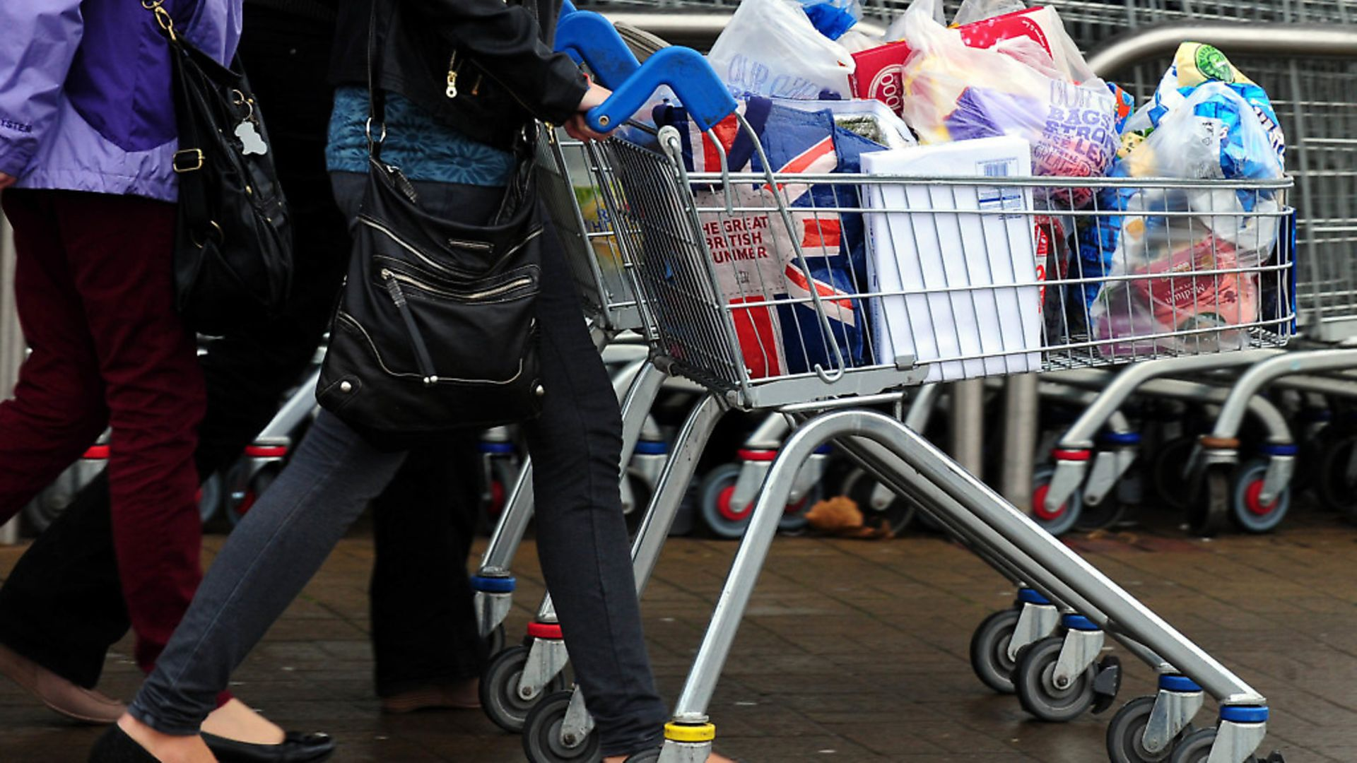 Customers leave a supermarket after food shopping. (Rui Vieira/PA) - Credit: PA Archive/PA Images