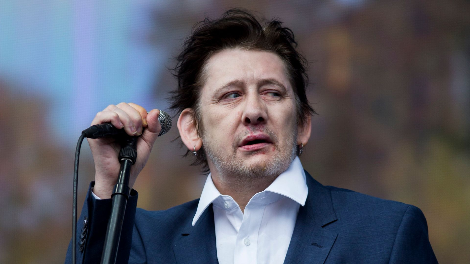 Shane MacGowan of The Pogues performs on stage at British Summer Time Festival. - Credit: Tristan Fewings/Getty Images